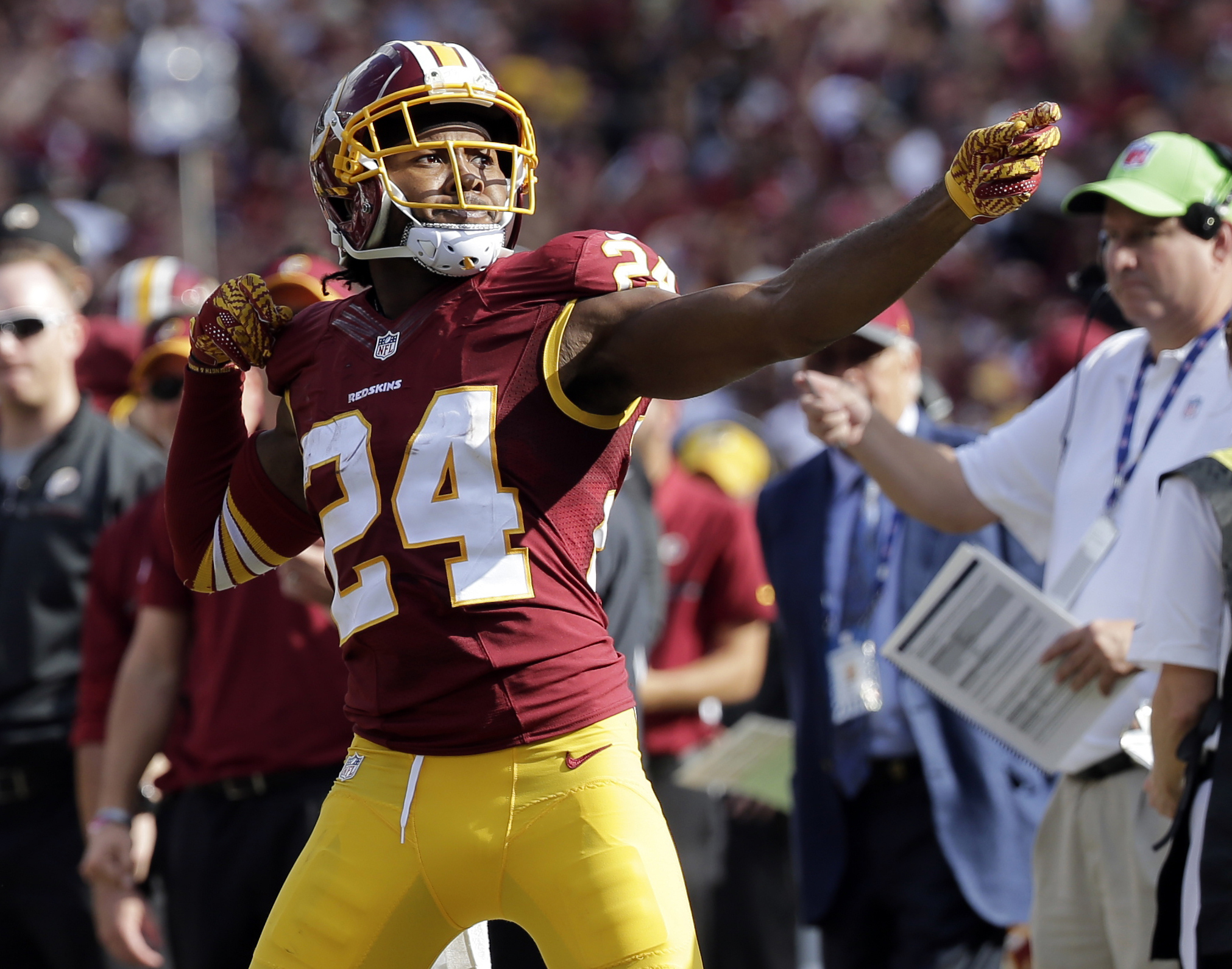 "FILE - In this Oct. 2, 2016, file photo, Washington Redskins cornerback Josh Norman (24) celebrates his interception with a ""bow and arrow,"" gesture and was penalized for the celebration during the second half of an NFL football game against the Cleveland"