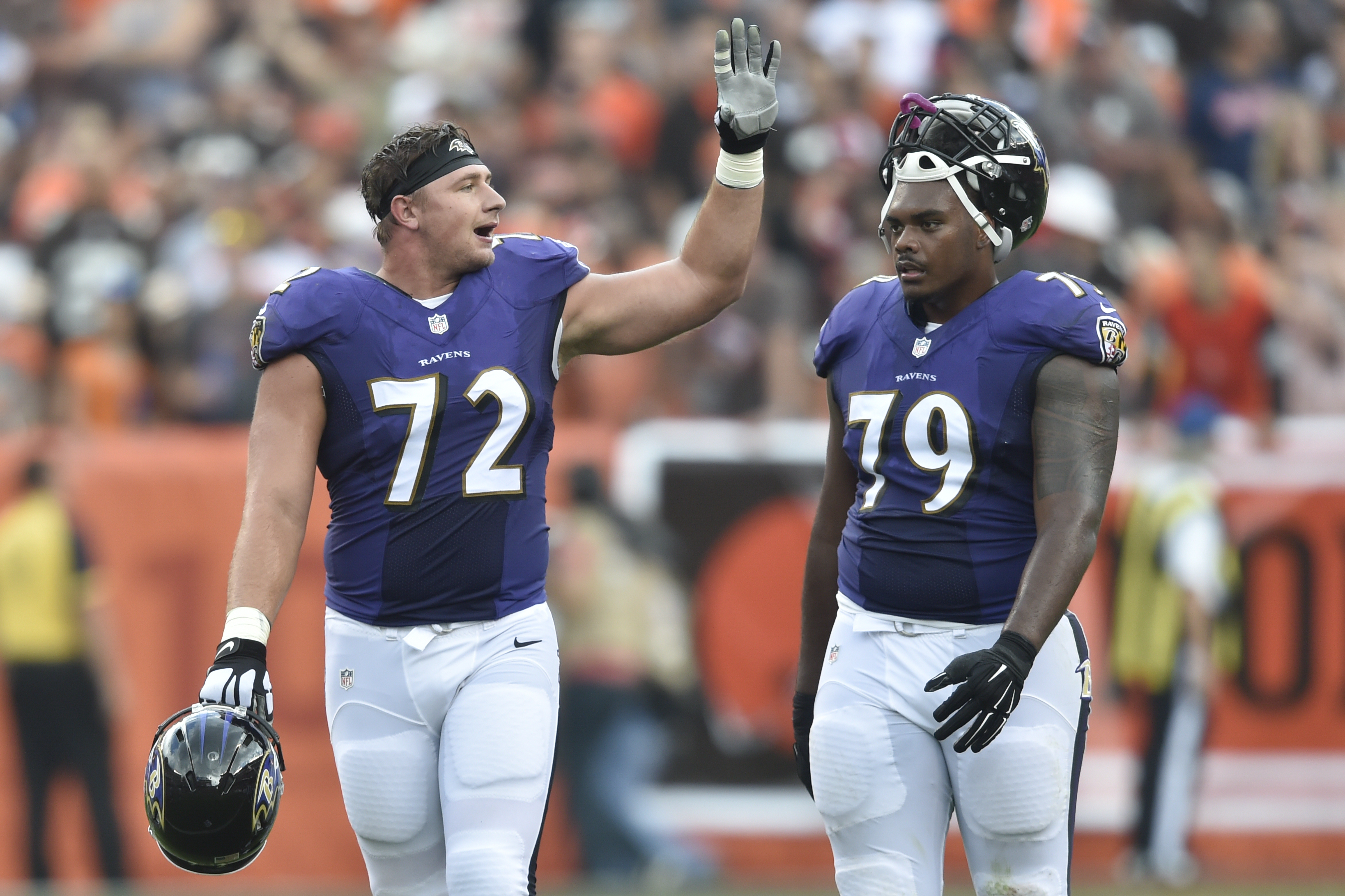FILE- In this Sept. 18, 2016, file photo, Baltimore Ravens offensive guard Alex Lewis (72) and offensive tackle Ronnie Stanley (79) stand on the field in the first half of an NFL football game against the Cleveland Browns in Cleveland.  Lewis, a fourth-ro
