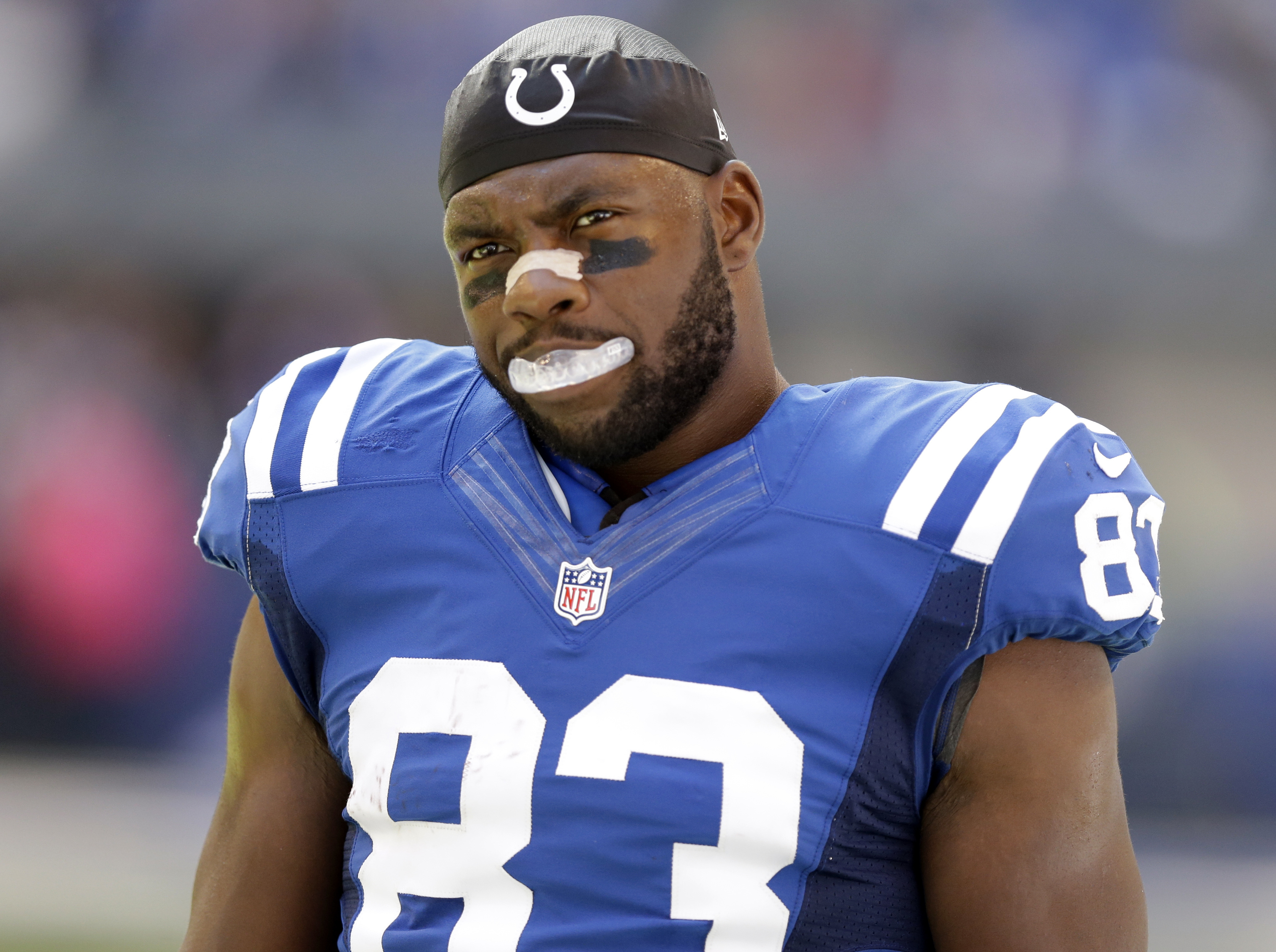 FILE - In this Sunday, Oct. 9, 2016, file photo, Indianapolis Colts tight end Dwayne Allen looks on before an NFL football game against the Chicago Bears in Indianapolis. Allen has dropped to his knee at the end of the national anthem since his rookie sea