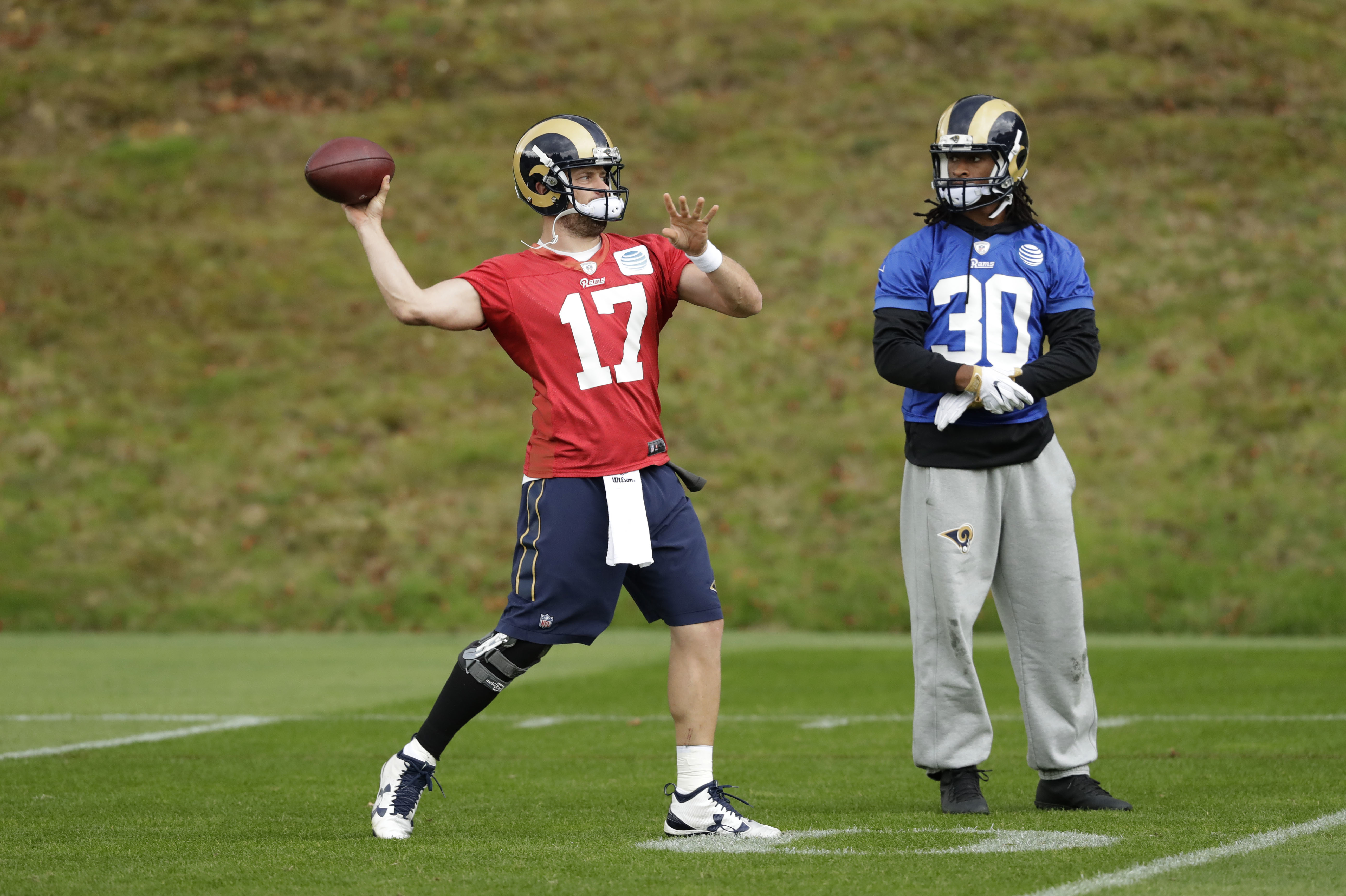Los Angeles Rams quarterback Case Keenum, left, and running back Todd Gurley take park in a practice session at Pennyhill Park Hotel in Bagshot, England, Thursday, Oct. 20, 2016. The Los Angeles Rams are due to play the New York Jets at Twickenham stadium