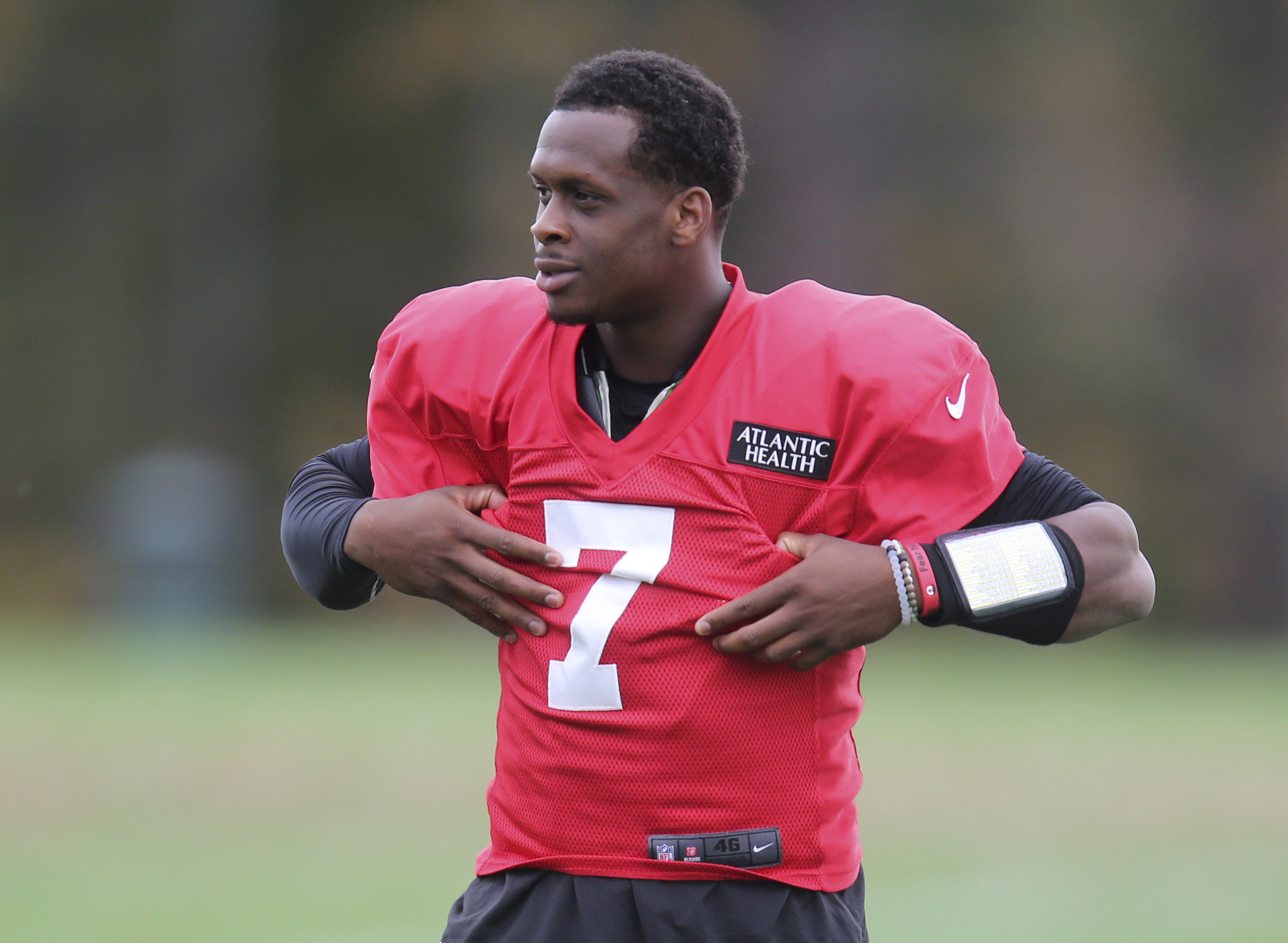 New York Jets quarterback Geno Smith adjusts his pads during a NFL football practice in Florham Park, N.J., Thursday, Oct. 20, 2016. Chan Gailey was Todd Bowles' hand-picked offensive coordinator when he was hired as Jets coach last year. After a terrific