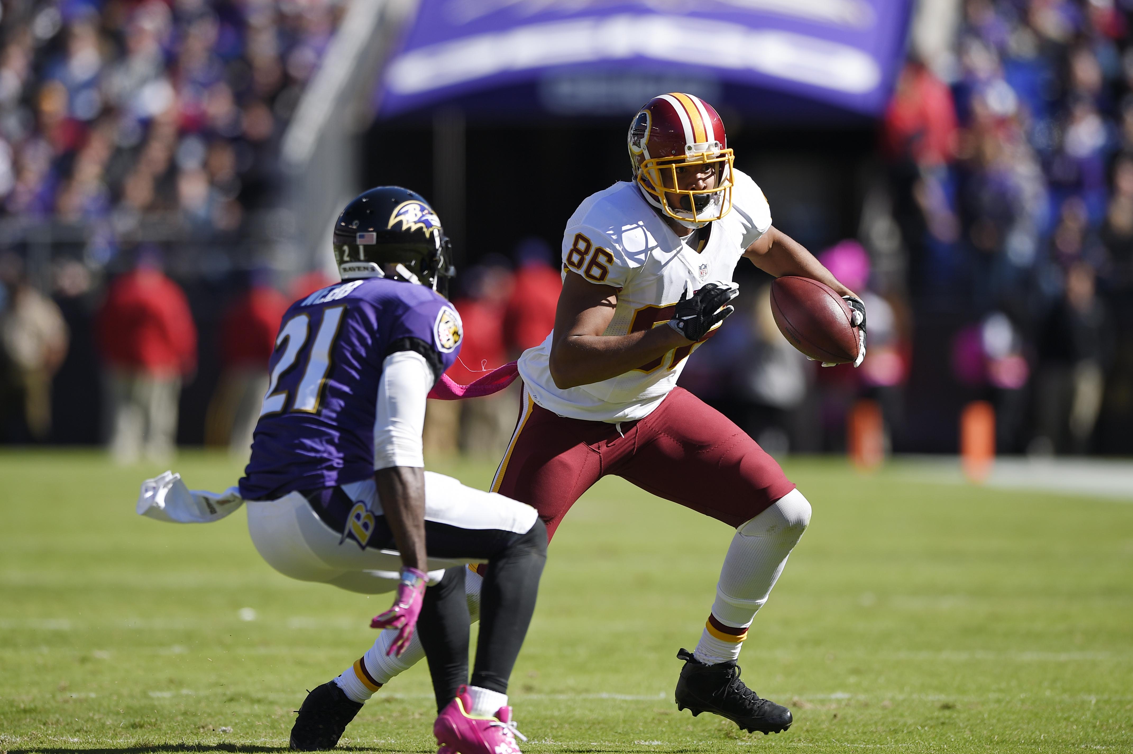 In this photo taken Oct. 9, 2016, Washington Redskins' Jordan Reed (86) runs against Baltimore Ravens' Lardarius Webb (21) during the first half of an NFL football game in Baltimore. Reed and Washington Redskins wide receiver Jackson have missed practice,