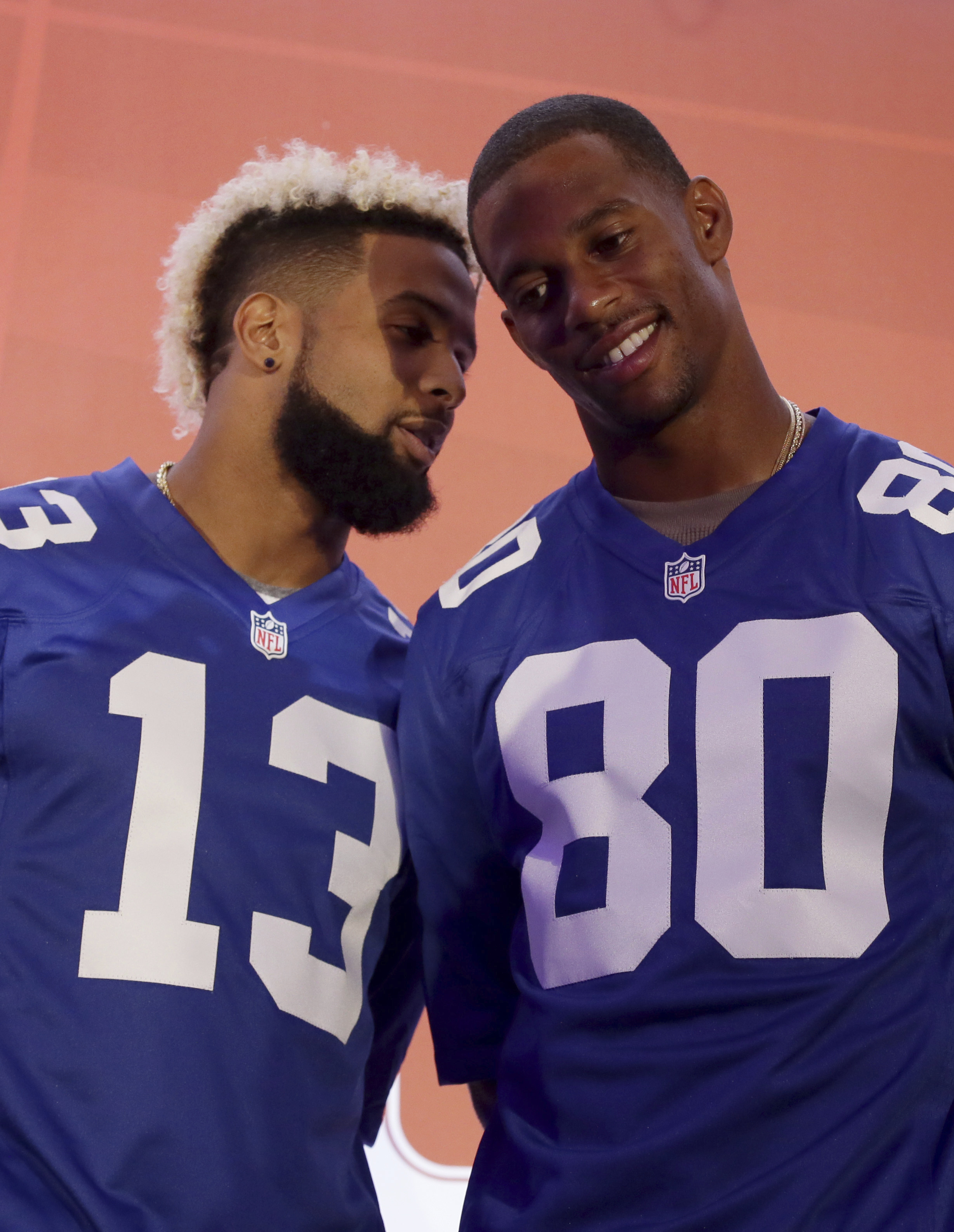 New York Giants wide receiver Victor Cruz, right, speaks with wide receiver Odell Beckham Jr on stage during an NFL Fan Rally at the NFL House in Victoria House, in London, Saturday Oct. 22, 2016. The Los Angeles Rams are due to play the New York Giants a
