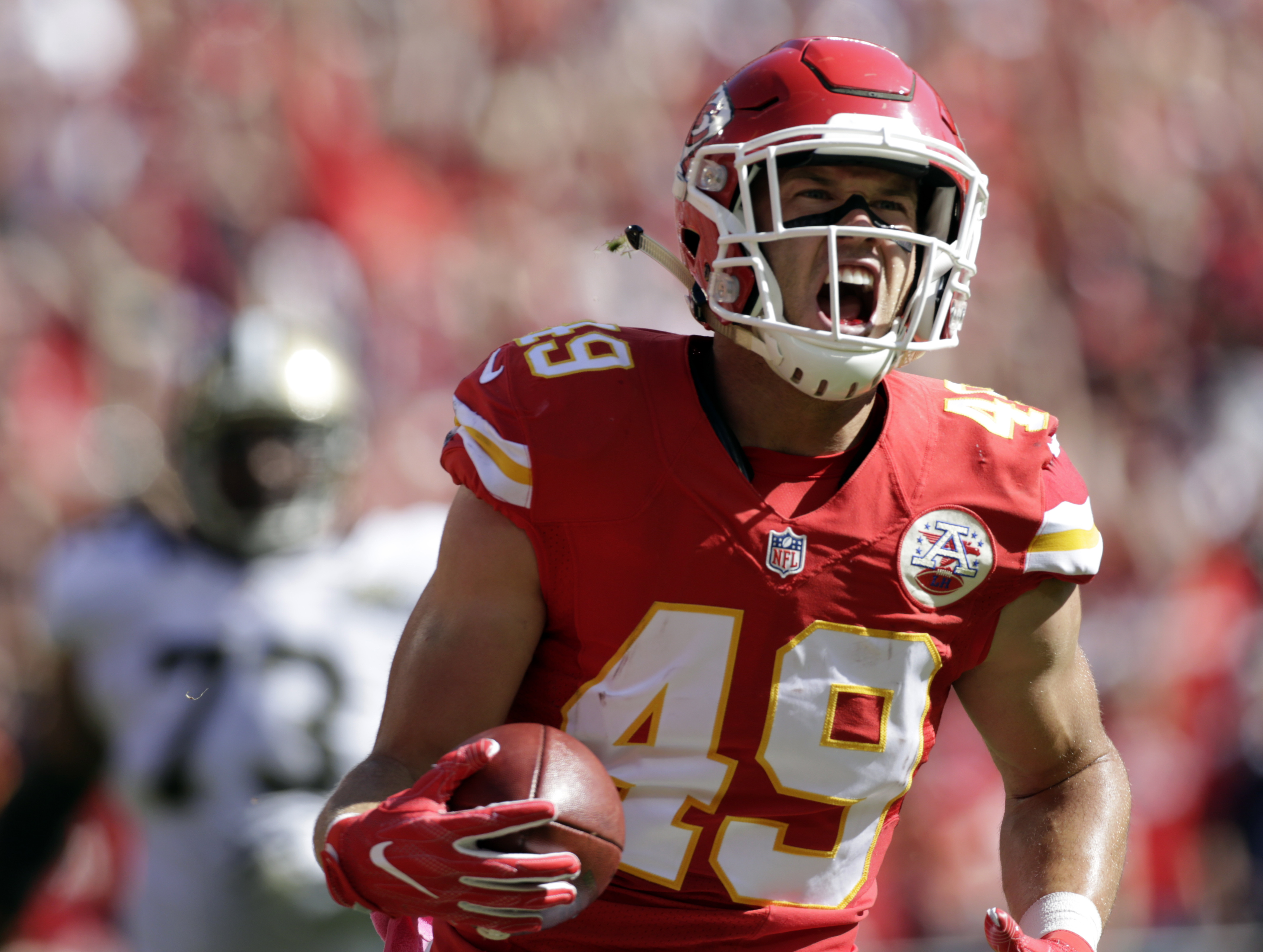 Kansas City Chiefs defensive back Daniel Sorensen (49) celebrates his touchdown following an interception of a throw by New Orleans Saints quarterback Drew Brees during the first half of an NFL football game in Kansas City, Mo., Sunday, Oct. 23, 2016. (AP