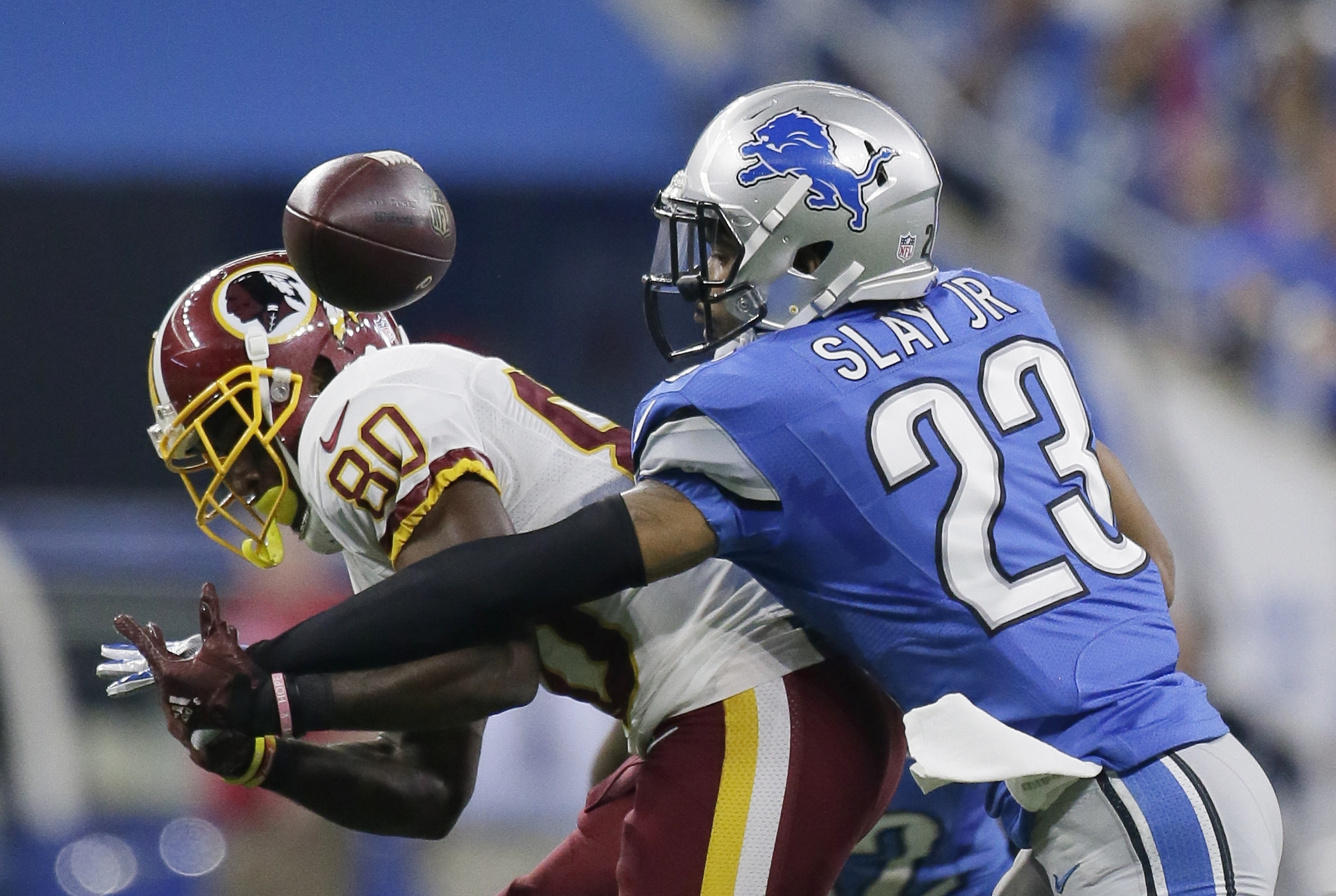 Detroit Lions cornerback Darius Slay (23) deflects a pass intended for Washington Redskins wide receiver Jamison Crowder (80) during the first half of an NFL football game, Sunday, Oct. 23, 2016 in Detroit. (AP Photo/Duane Burleson)