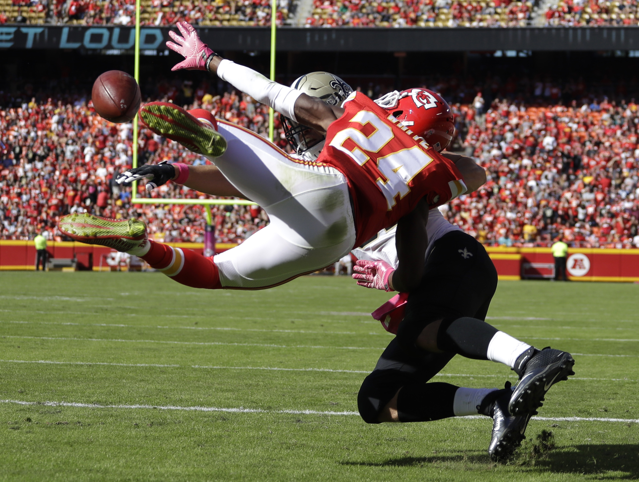 Kansas City Chiefs defensive back D.J. White (24) attempts to catch the ball while defended by New Orleans Saints tight end Coby Fleener (82), during the second half of an NFL football game in Kansas City, Mo., Sunday, Oct. 23, 2016. The play was negated