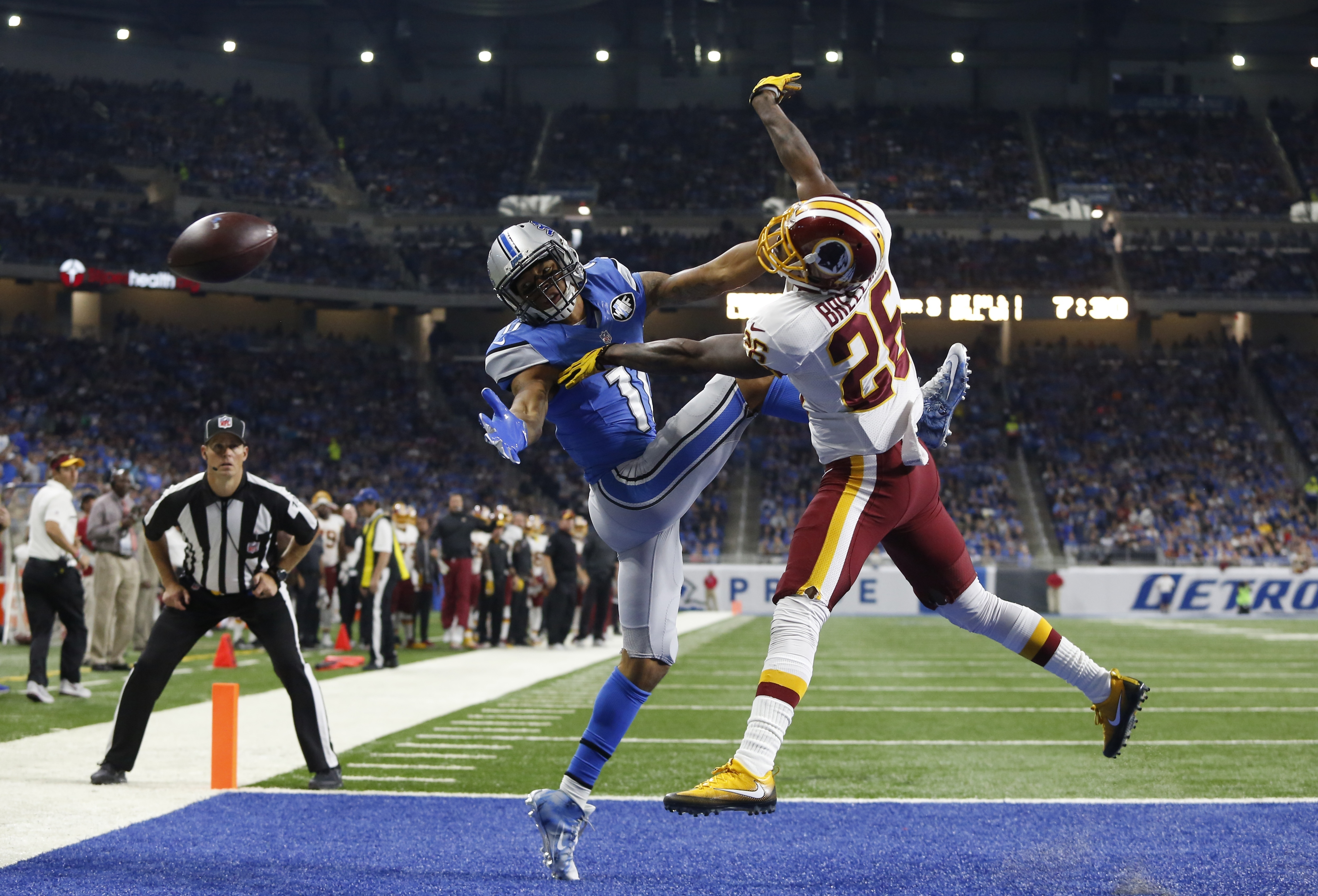 Washington Redskins cornerback Bashaud Breeland (26) deflects a pass intended for Detroit Lions wide receiver Marvin Jones (11) during the second half of an NFL football game, Sunday, Oct. 23, 2016 in Detroit. (AP Photo/Duane Burleson)