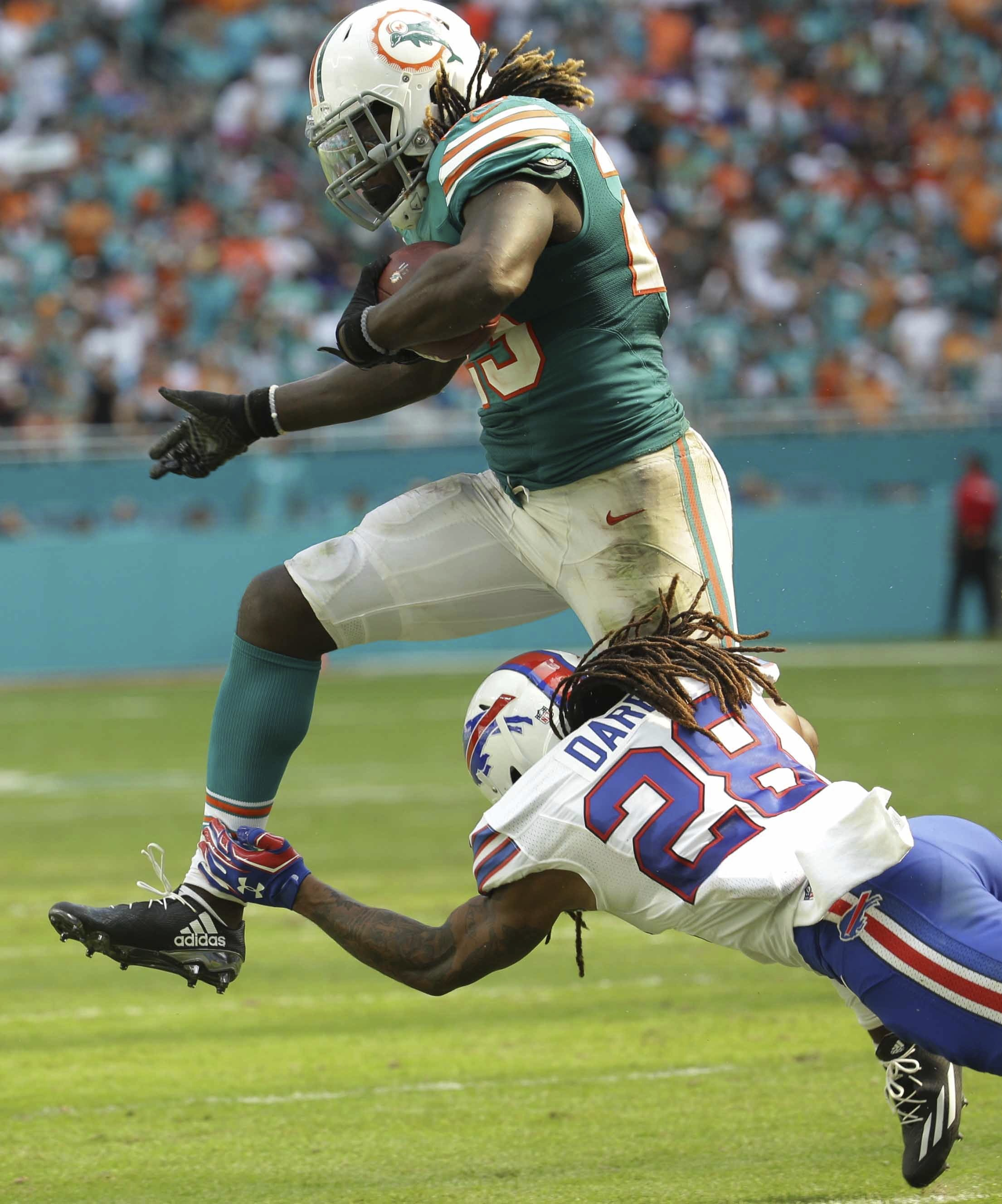 Buffalo Bills cornerback Ronald Darby (28) attempts to tackle Miami Dolphins running back Jay Ajayi (23), during the second half of an NFL football game, Sunday, Oct. 23, 2016, in Miami Gardens, Fla. (AP Photo/Lynne Sladky)