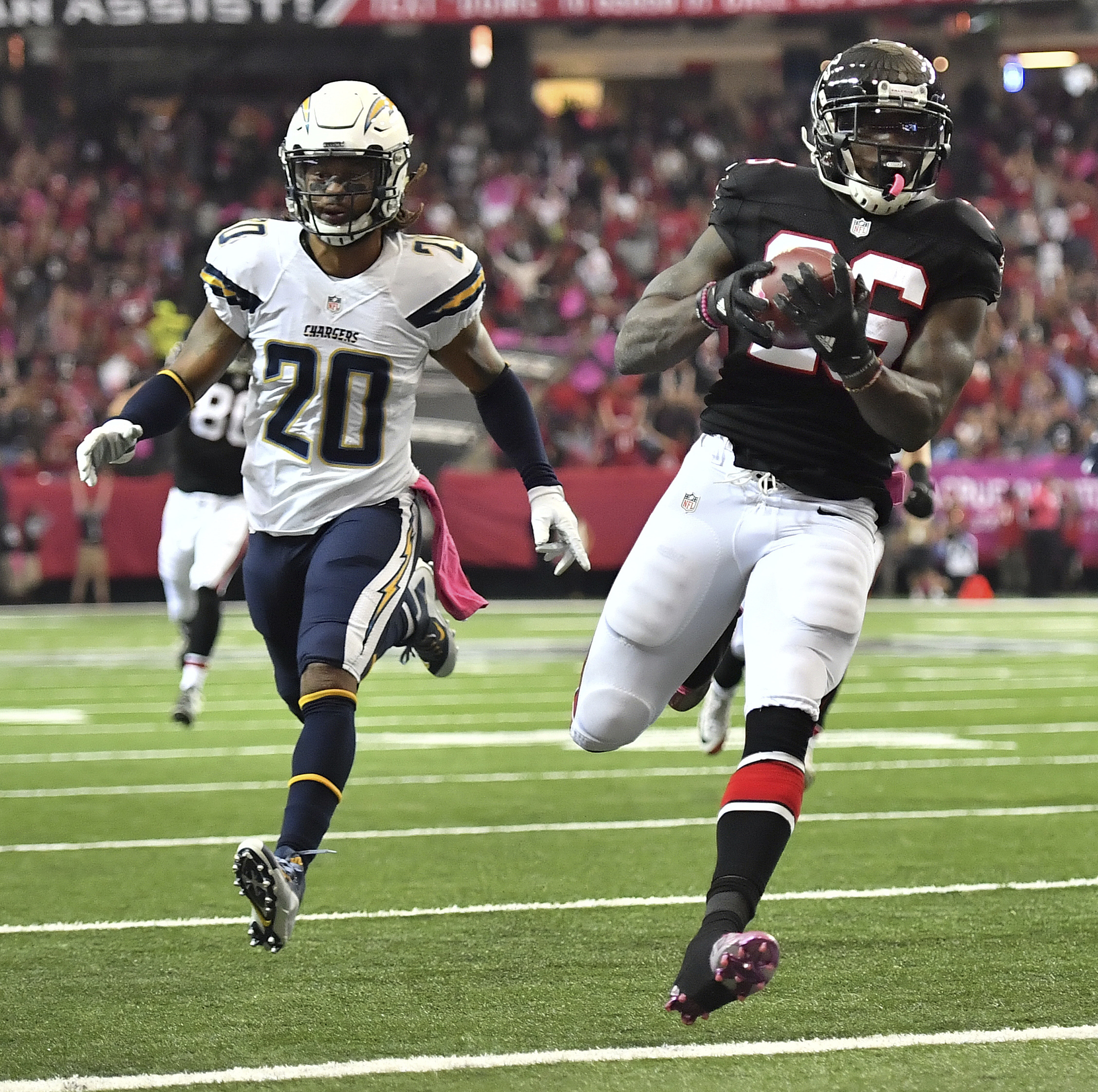 Atlanta Falcons running back Tevin Coleman (26) runs into the end zone for a touchdown against San Diego Chargers free safety Dwight Lowery (20) during the first half of an NFL football game between the Atlanta Falcons and the San Diego Chargers, Sunday,