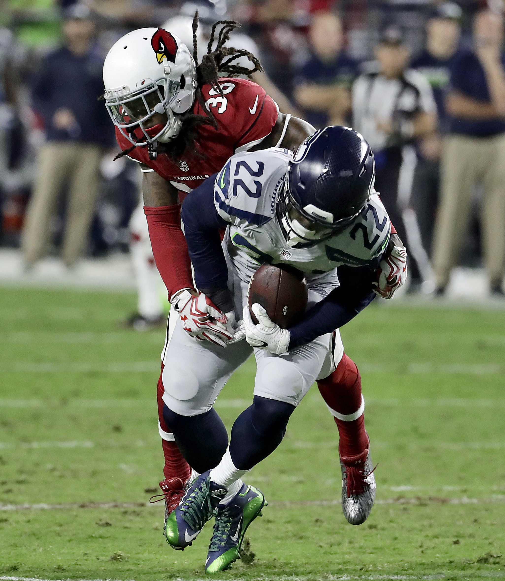 Seattle Seahawks running back C.J. Prosise (22) is hit short of a first down by Arizona Cardinals defensive back D.J. Swearinger (36) during the second half of a football game, Sunday, Oct. 23, 2016, in Glendale, Ariz. (AP Photo/Rick Scuteri)