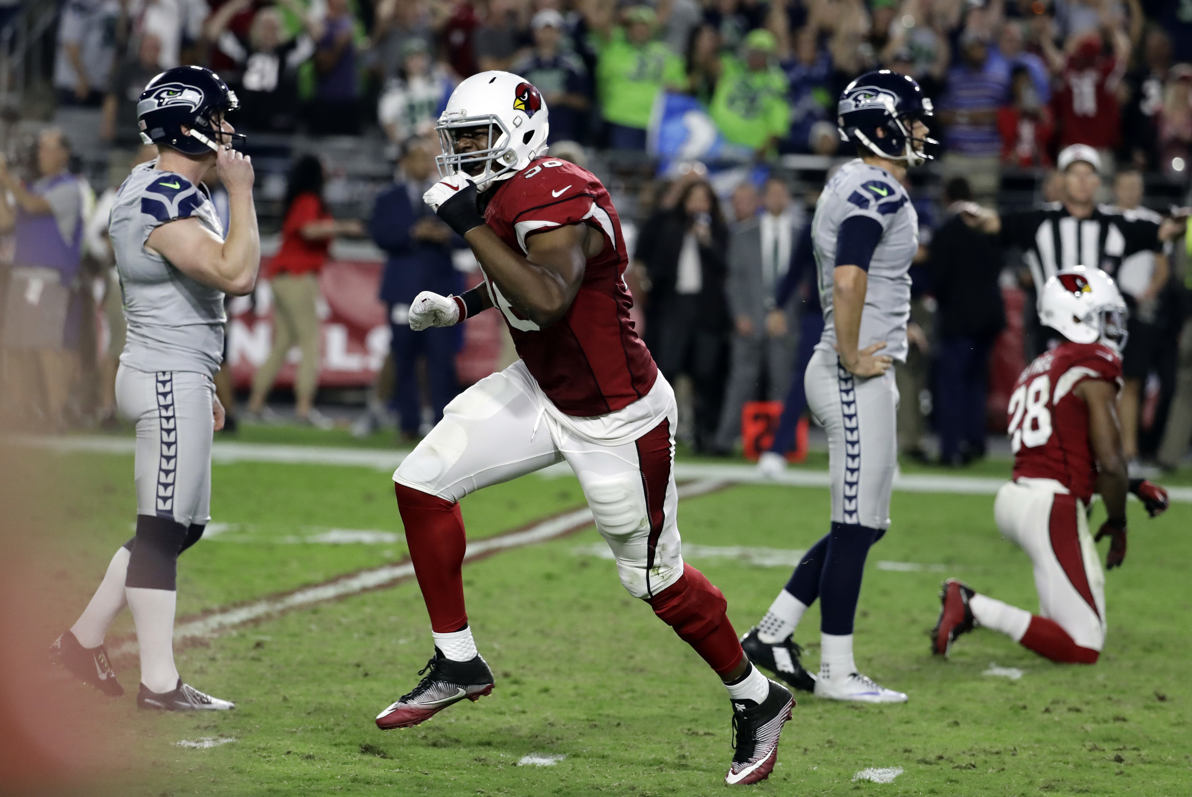Arizona Cardinals linebacker Kareem Martin, center, reacts to Seattle Seahawks kicker Stephen Hauschka's, left, missed game-winning field goal attempt during overtime an NFL football game against the Arizona Cardinals, Sunday, Oct. 23, 2016, in Glendale,