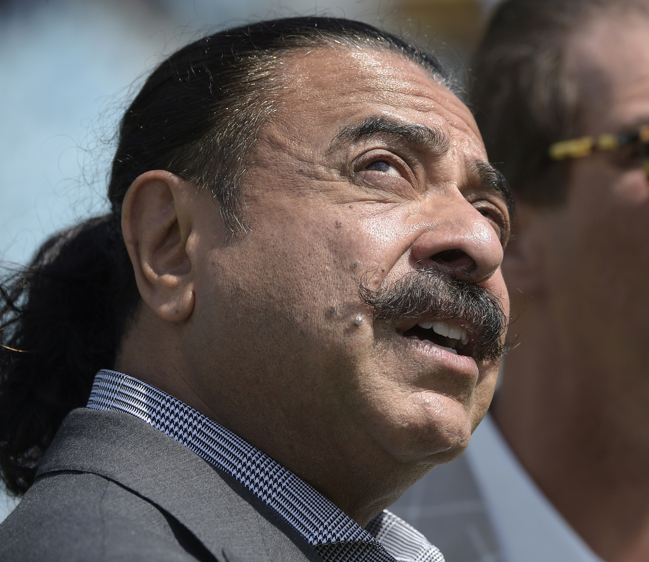 FILE - In this Sept. 25, 2016, file photo, Jacksonville Jaguars owner Shad Khan is shown before an NFL football game in Jacksonville, Fla.  Jaguars owner Shad Khan made a rare appearance in front of the team a day after one of the most embarrassing losses
