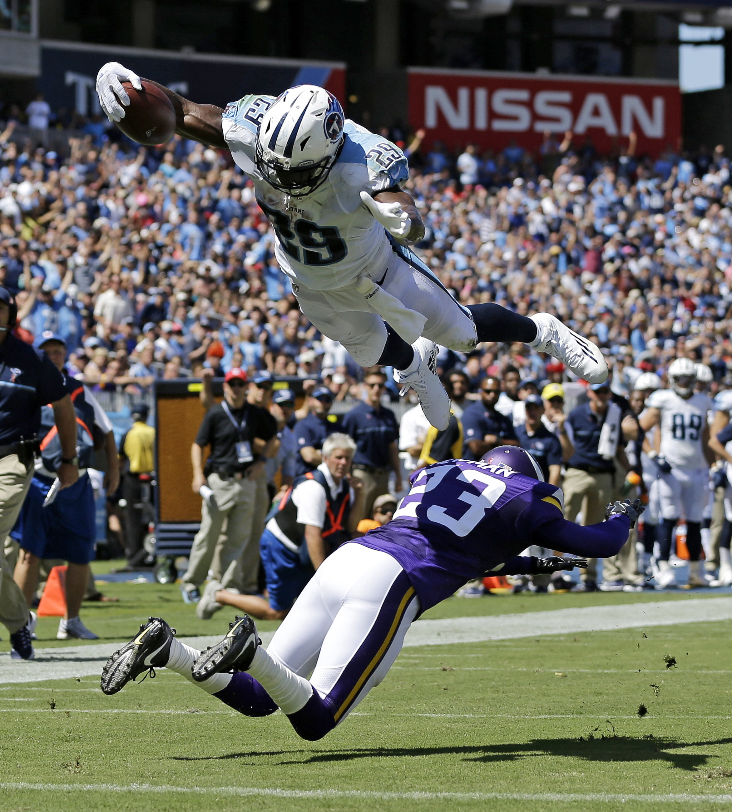 FILE - In this Sept. 11, 2016, file photo, Tennessee Titans running back DeMarco Murray (29) dives over Minnesota Vikings cornerback Terence Newman (23) as Murray scores a touchdown on a 6-yard pass reception in the first half of an NFL football game, in
