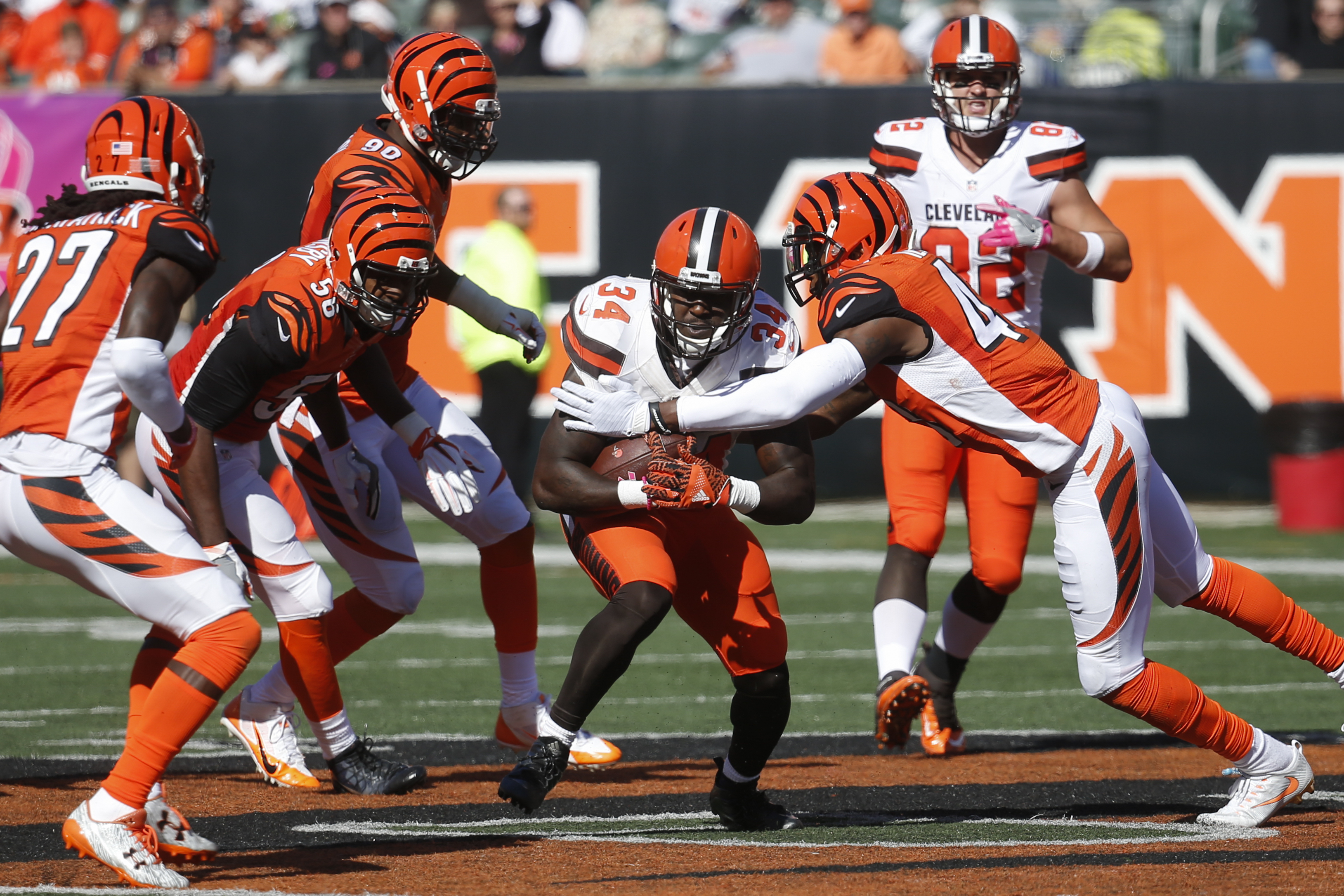 FILE - In this Sunday, Oct. 23, 2016, file photo, Cleveland Browns running back Isaiah Crowell (34) runs the ball through a host of Cincinnati Bengals defenders in the second half of an NFL football game in Cincinnati. The Bengals defense has had trouble