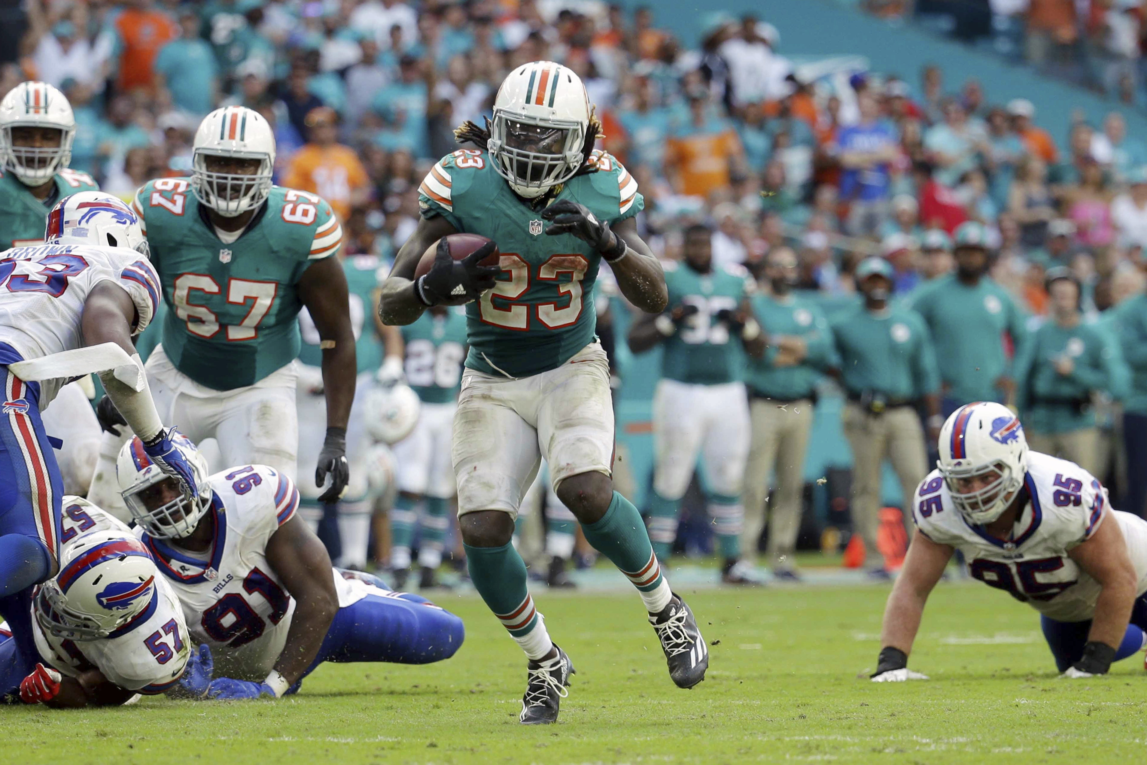 FILE - In this Oct. 23, 2016, file photo, Miami Dolphins running back Jay Ajayi (23) runs the ball during the second half of an NFL football gam against the Buffalo Bills, in Miami Gardens, Fla. Ajayi offered to buy his blockers dinner after his first car