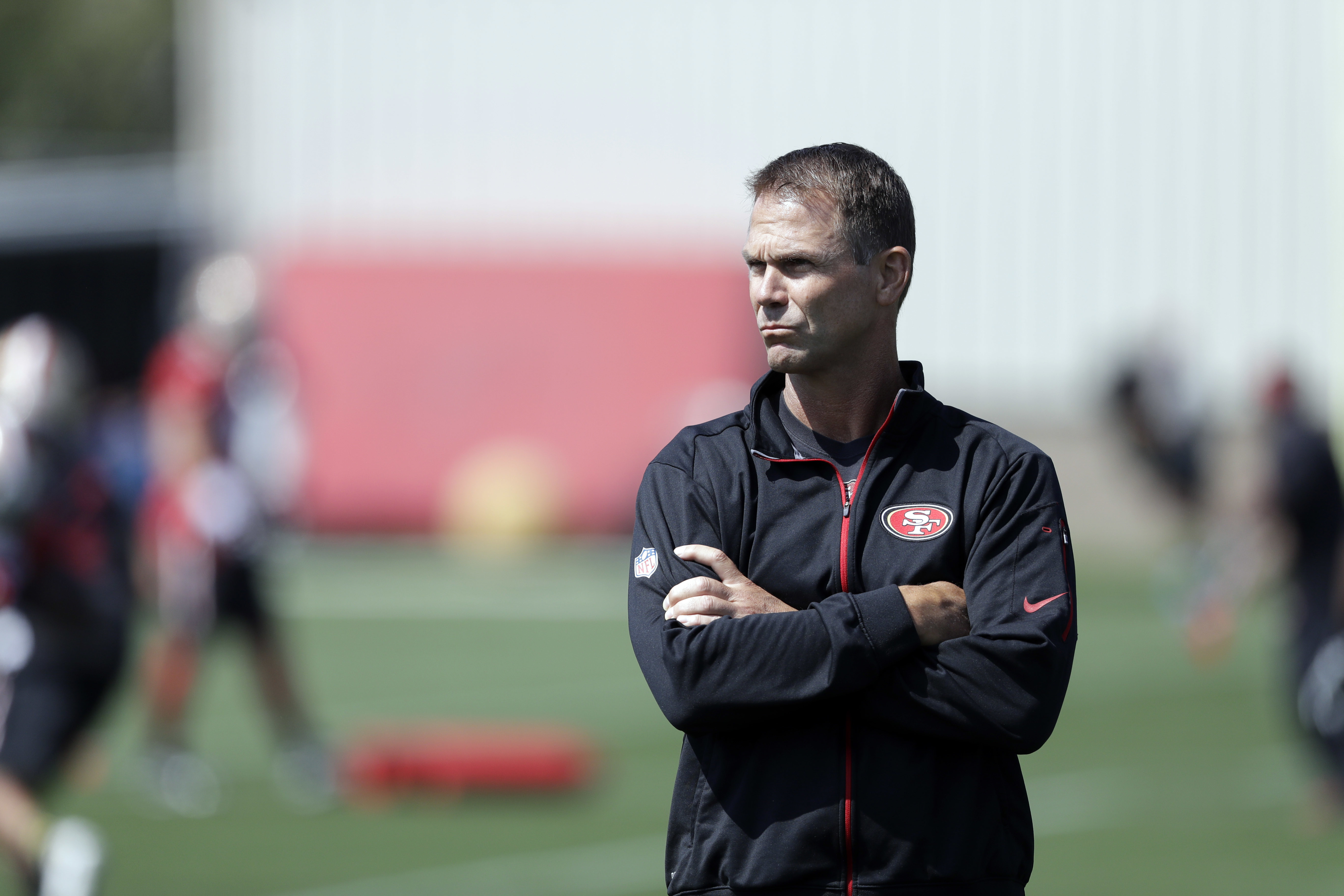 This July 31, 2016, photo shows San Francisco 49ers general manager Trent Baalke during NFL football training camp in Santa Clara, Calif. Fresh off his team's sixth straight loss, San Francisco linebacker Aaron Lynch made a bold proclamation that the 49er
