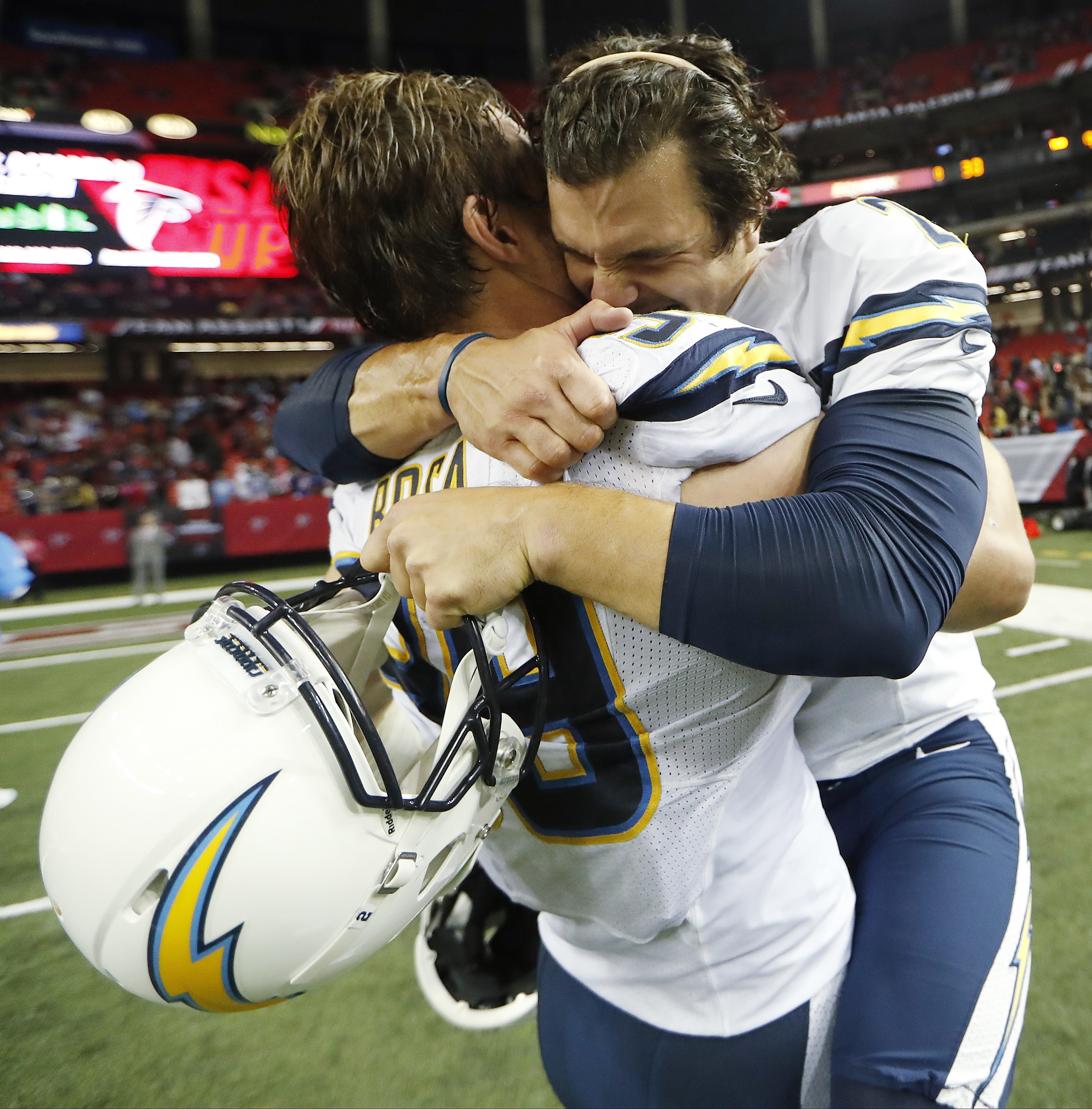 FILE - In this Oct. 23, 2016, file photo, San Diego Chargers kicker Josh Lambo, right embraces Chargers defensive end Joey Bosa (99) after Lambo kicked the game winning field goal in overtime of an NFL football game in Atlanta. Don't twerk. Don't pretend