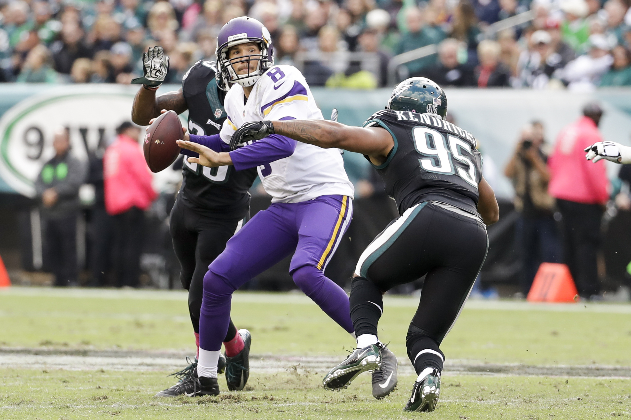 FILE - In this Oct. 23, 2016, file photo, Minnesota Vikings quarterback Sam Bradford (8) is shown under pressure by Philadelphia Eagles free safety Rodney McLeod (23) and outside linebacker Mychal Kendricks (95) during an NFL football game in Philadelphia