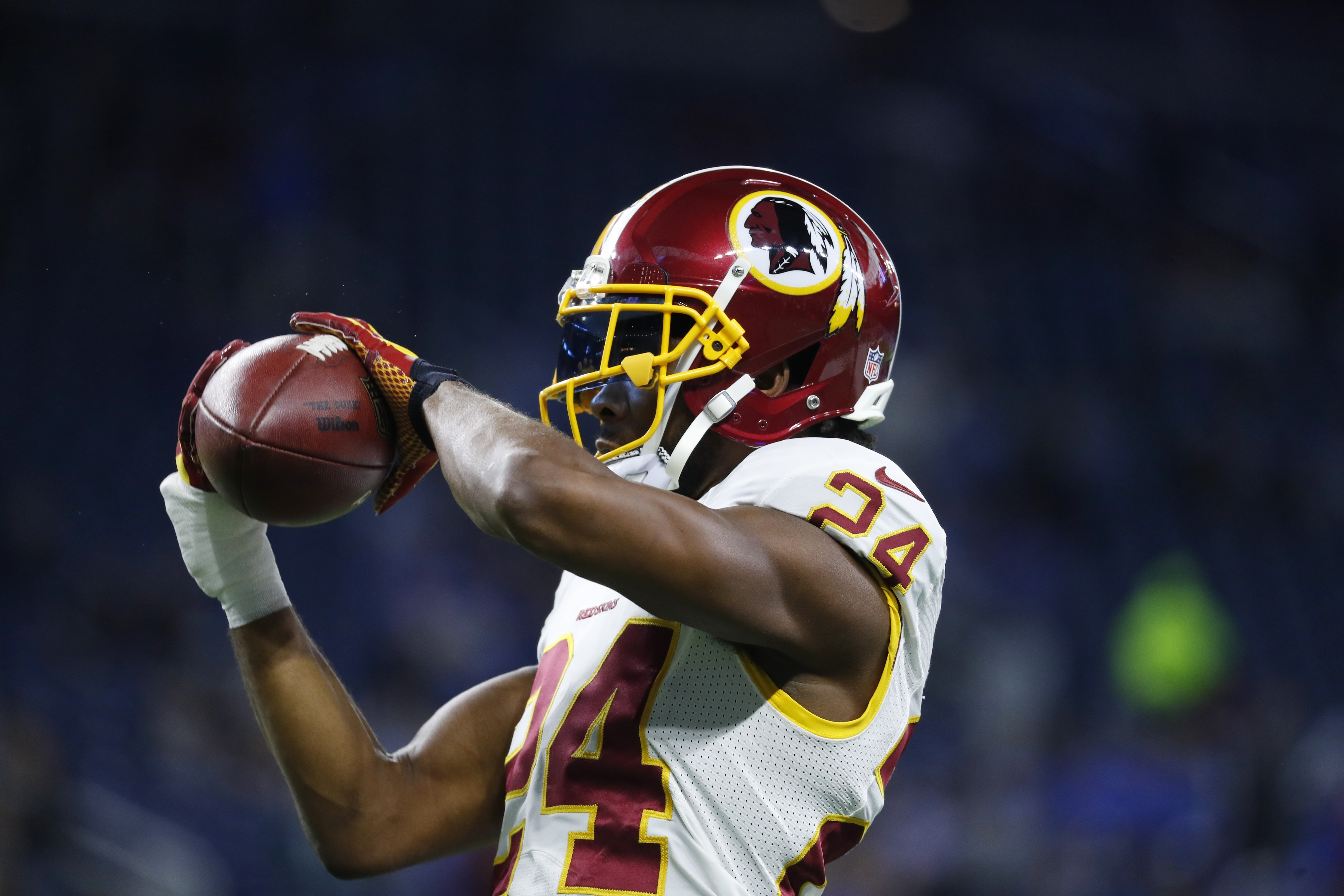 In this photo taken Oct. 23, 2016, Washington Redskins cornerback Josh Norman makes a catch during pre game of an NFL football game against the Detroit Lions in Detroit. Norman and Washington Redskins tight end Jordan Reed have been cleared to fly with th