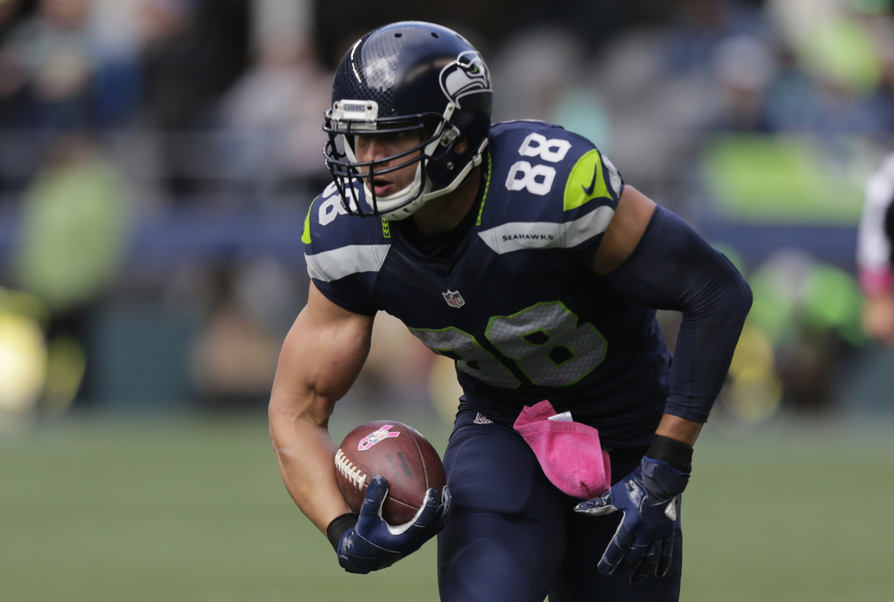 FILE - In this Oct. 16, 2016, file photo, Seattle Seahawks tight end Jimmy Graham runs the ball after a reception during an NFL football game against the Atlanta Falcons in Seattle. An NFL football game Sunday, Oct. 30, 2016, will mark the first time Grah