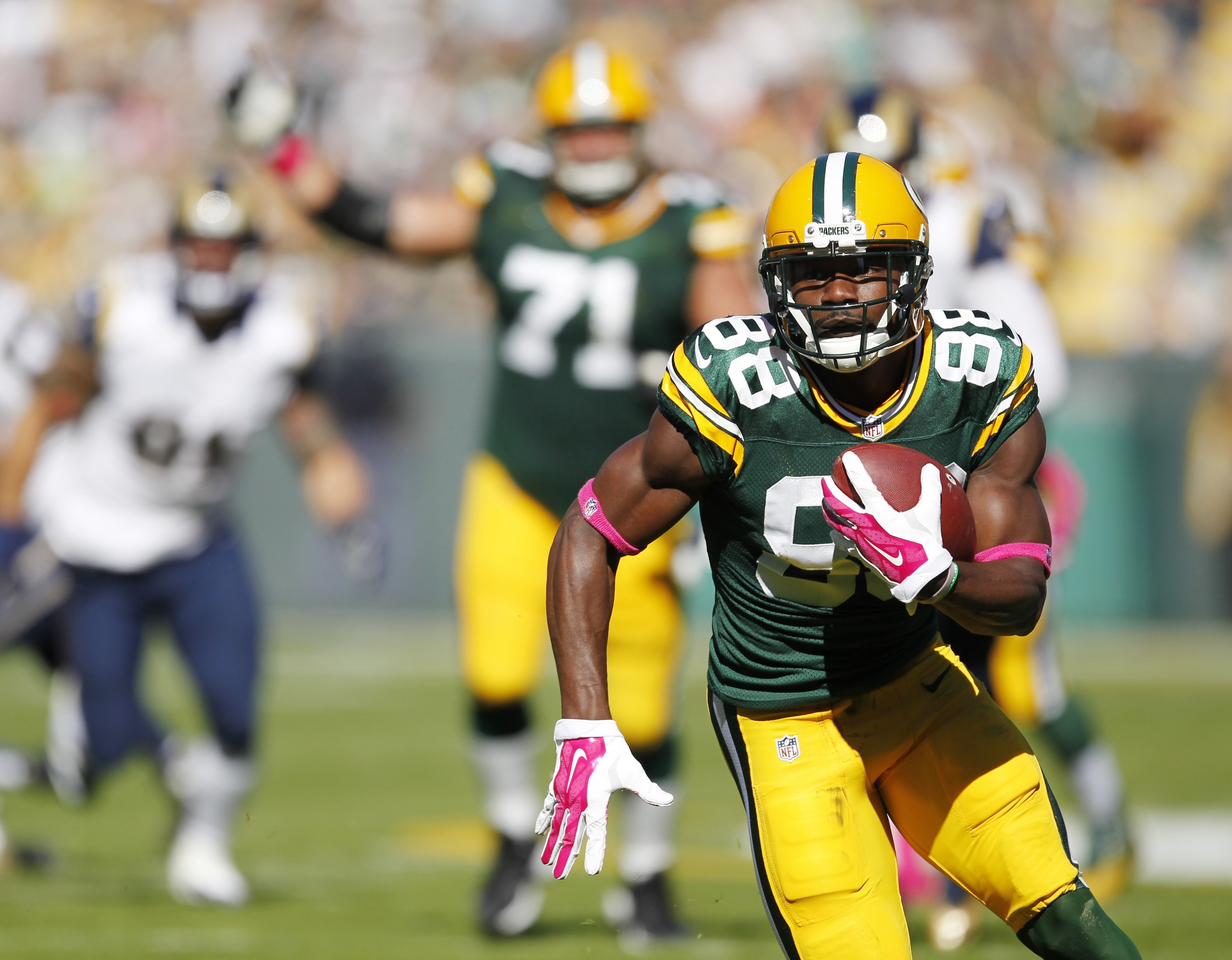 FILE - In this Oct. 11, 2015, file photo, Green Bay Packers' Ty Montgomery catches a touchdown pass during the first half an NFL football game against the St. Louis Rams in Green Bay, Wis. As a rookie in 2015, Montgomery had some success in a change-of-pa