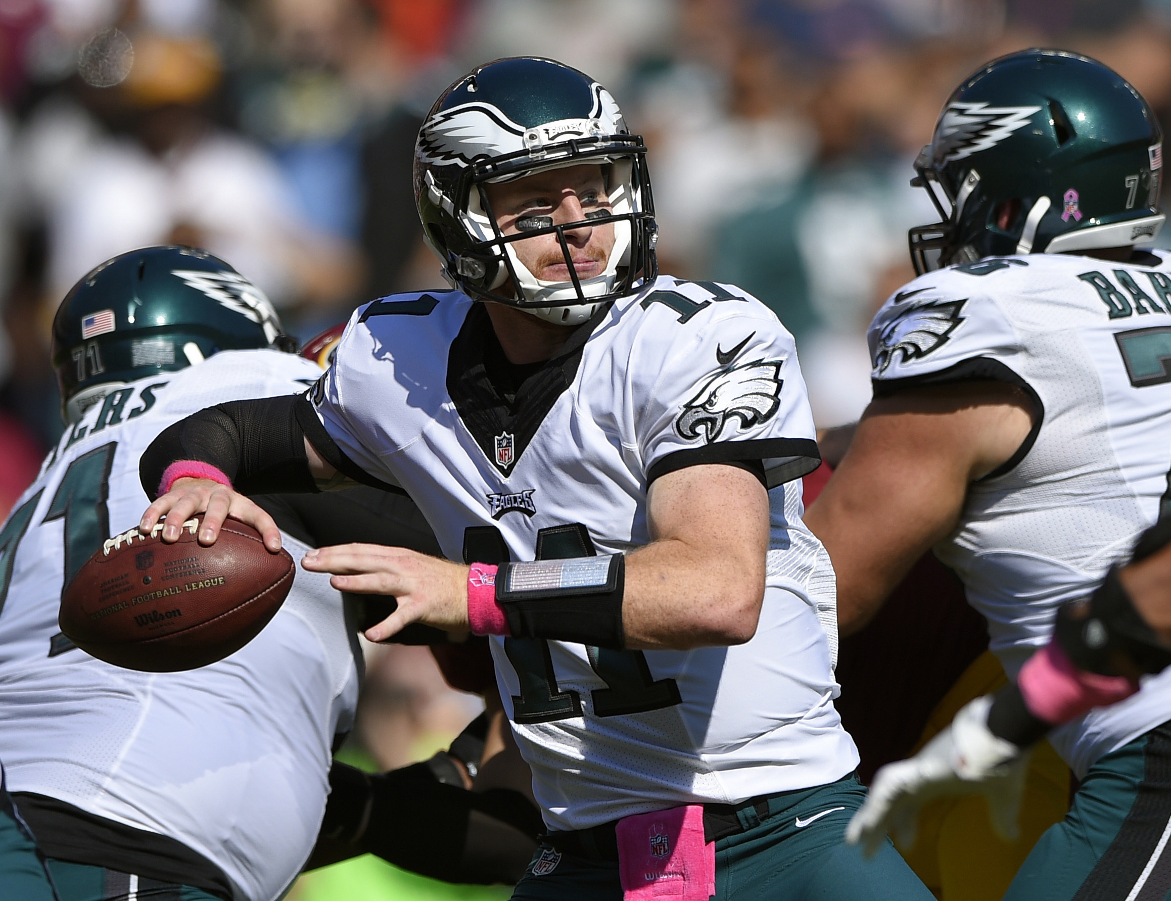 FILE - In this Sunday, Oct. 16, 2016, file photo, Philadelphia Eagles quarterback Carson Wentz throws to a receiver in the first half of an NFL football game against the Washington Redskins in Landover, Md. Wentz leads NFL rookies with eight passing TDs.