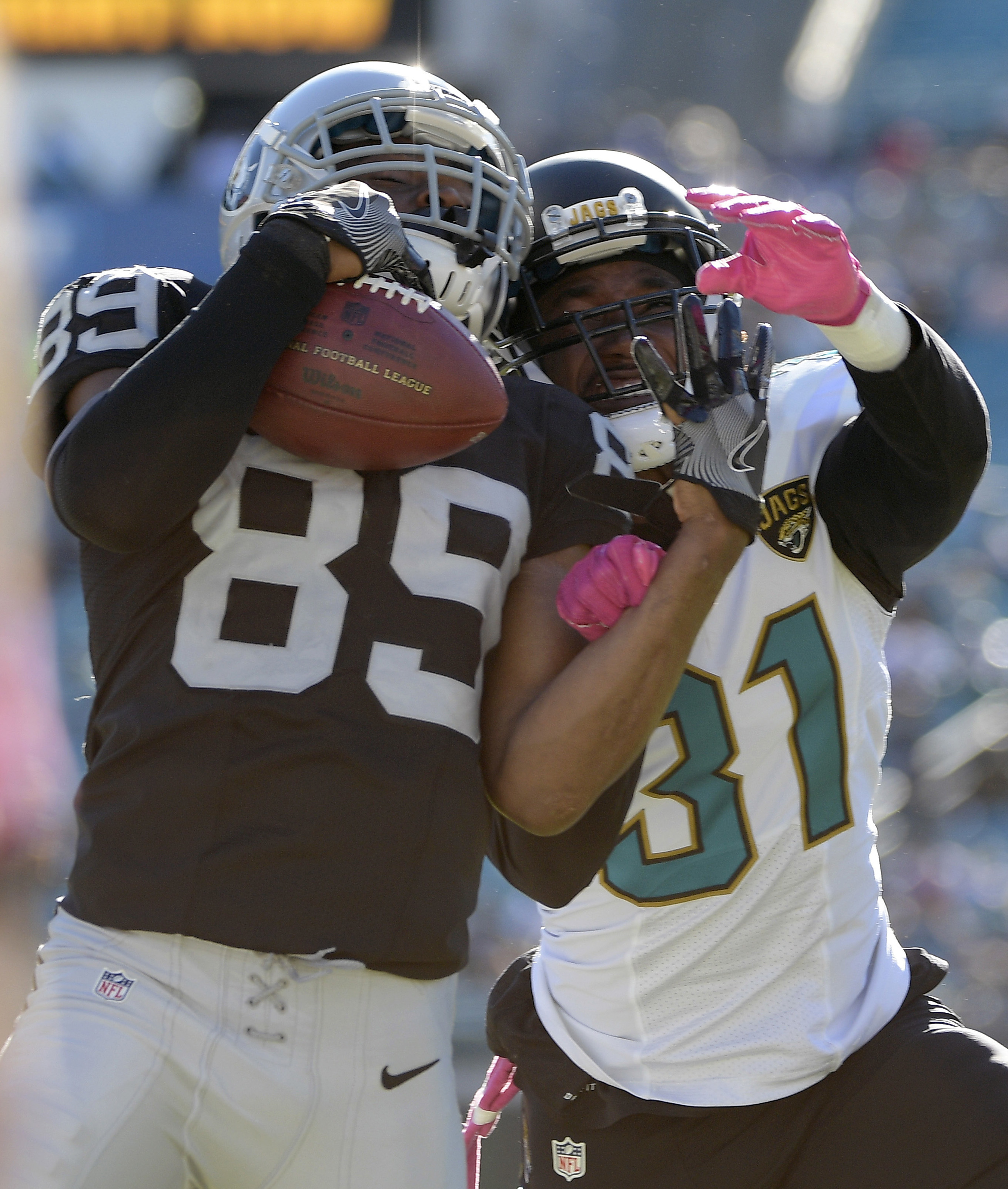 FILE - In this Oct. 23, 2016, file photo, Oakland Raiders wide receiver Amari Cooper (89) makes a catch in front of Jacksonville Jaguars cornerback Davon House (31) during the fourth quarter of an NFL football game in Jacksonville, Fla. Tampa Bay first-ro
