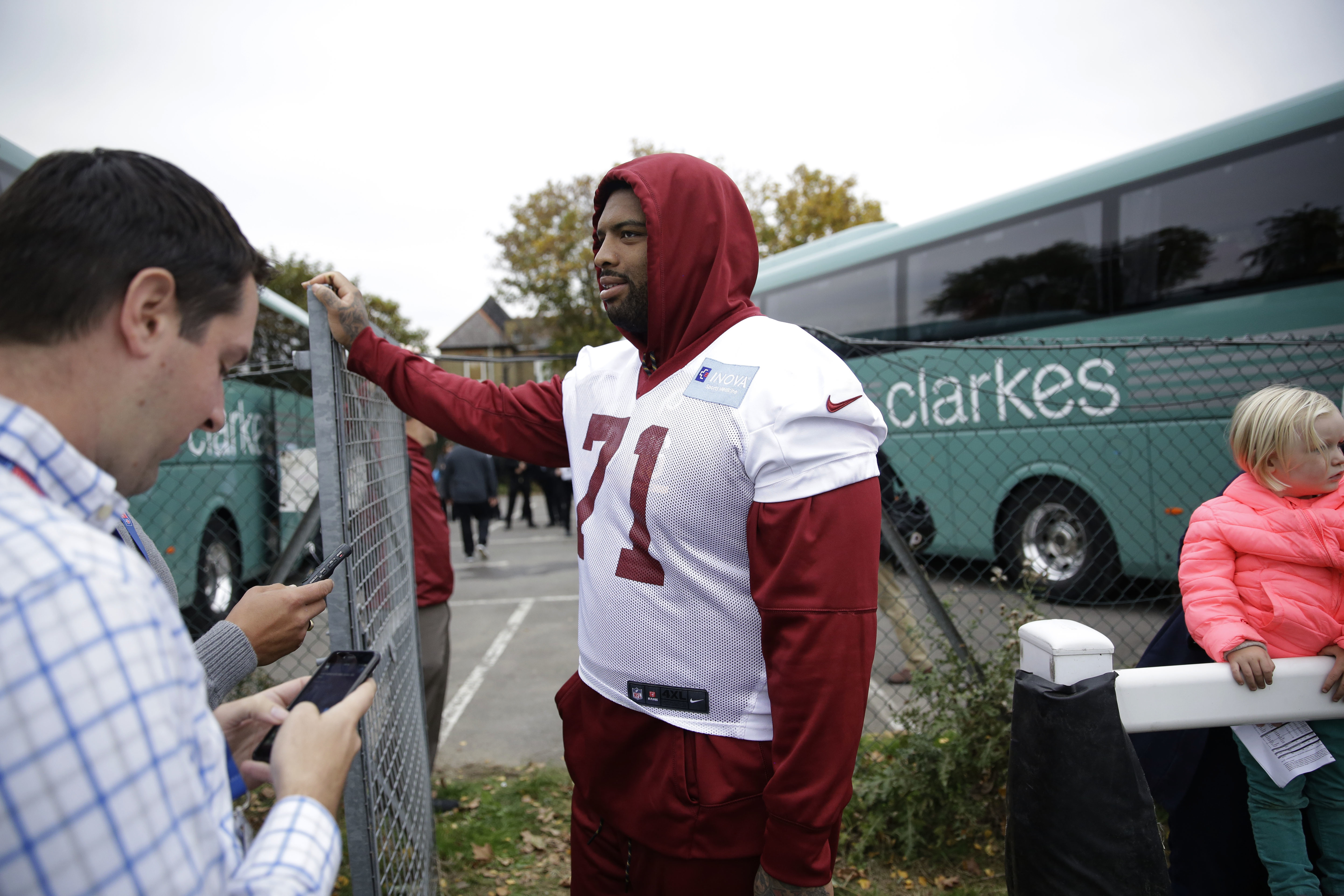 Washington Redskins' offensive tackle Trent Williams, 71, who is recovering from an injury, speaks to journalists after a training session at Wasps rugby union team training ground in west London, Friday, Oct. 28, 2016. The Washington Redskins are due to