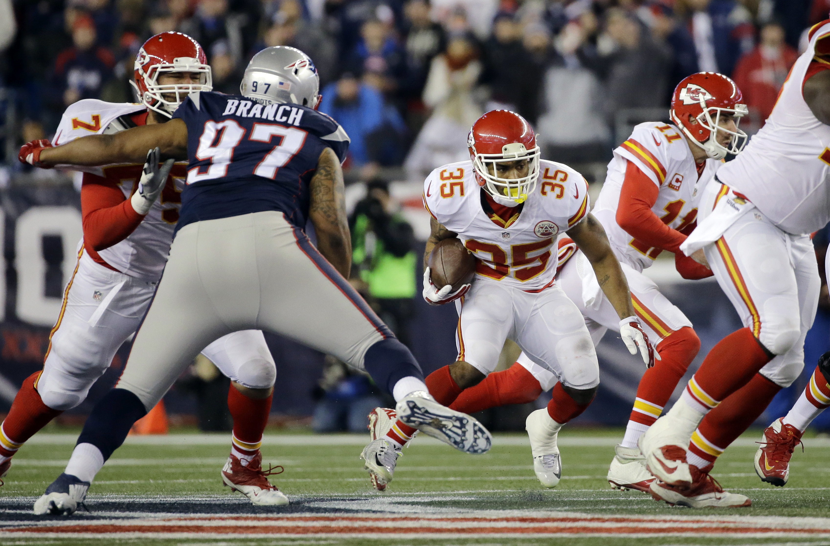 In this photo taken Jan.16, 2016, New England Patriots defensive tackle Alan Branch (97) closes in on Kansas City Chiefs running back Charcandrick West (35)  in the first half of an NFL divisional playoff football game, in Foxborough, Mass. Moves are few
