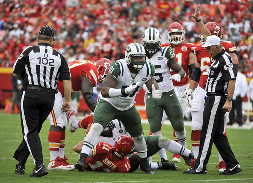 FILE - In this Sept. 25, 2016, file photo, New York Jets defensive end Sheldon Richardson (91) celebrates after sacking Kansas City Chiefs quarterback Alex Smith (11) during an NFL football game in Kansas City, Mo. Richardson has split his time this seaso