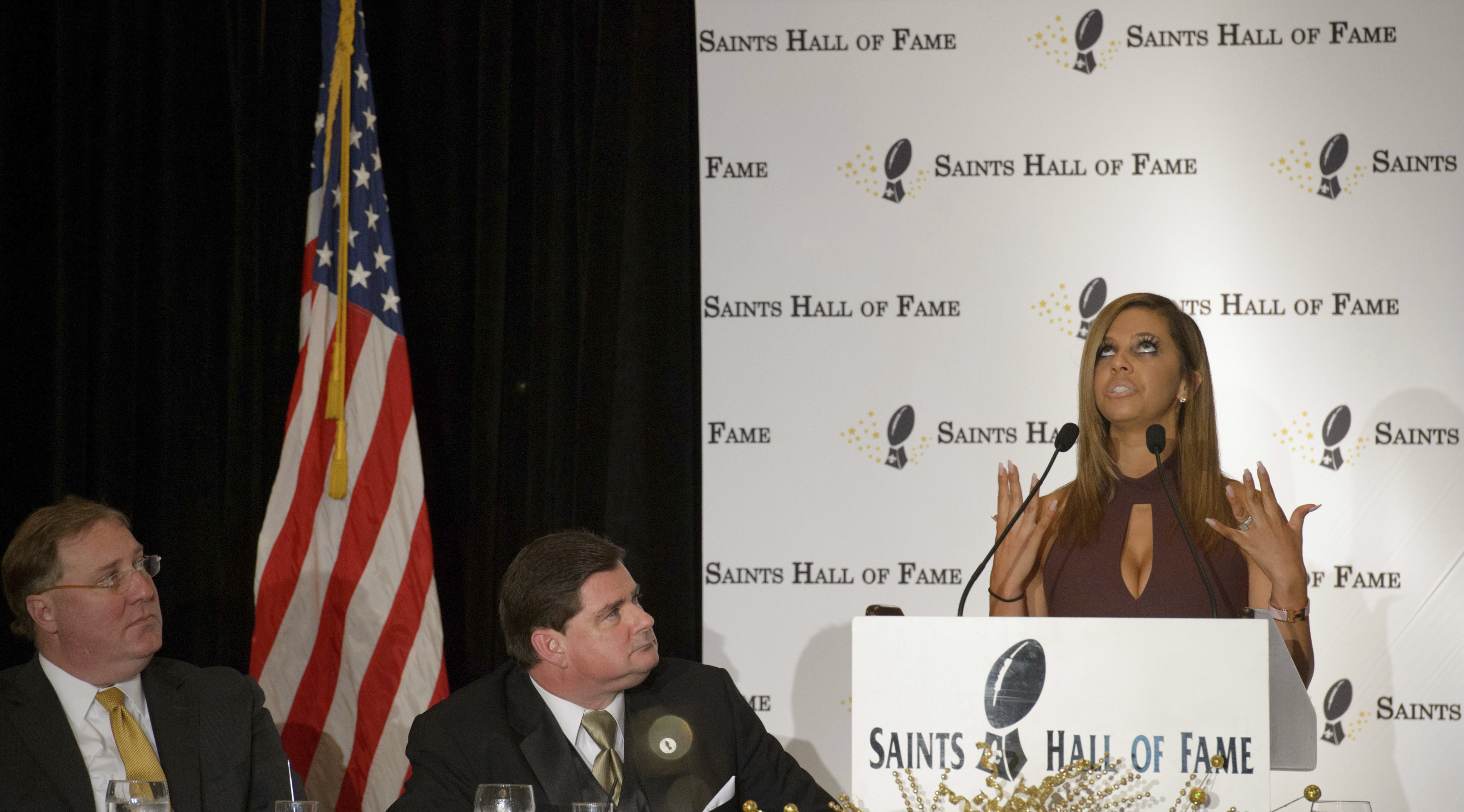 Looking up to the heavens, Racquel Smith speaks to her husband, slain New Orleans Saints defensive end Will Smith, and tells him that she is proud of him, at the New Orleans Saints Hall of Fame luncheon in Kenner, La., Friday, Oct. 28, 2016. Dennis Lausch