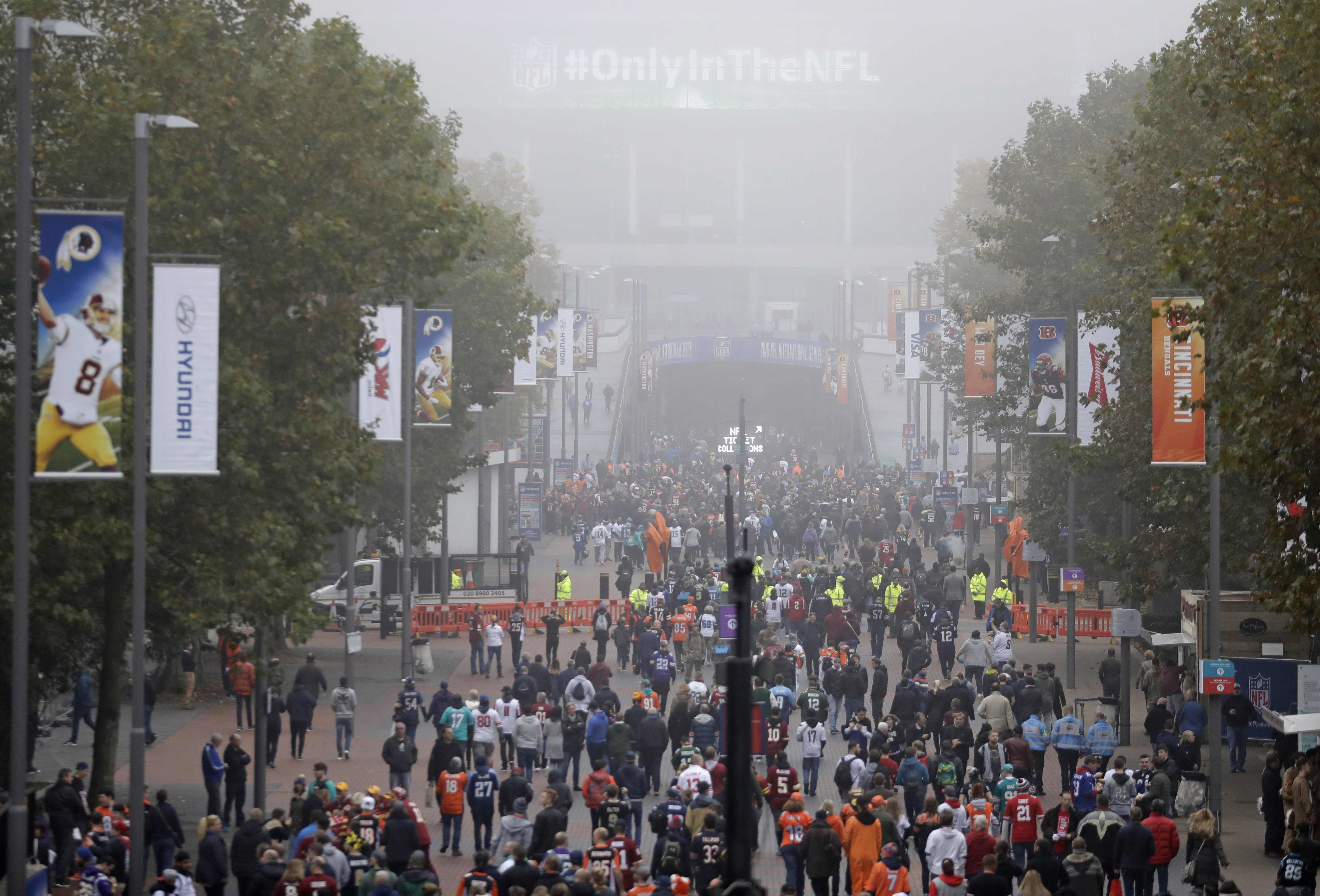 Fog shrouds Wembley Way as fans arrive for an NFL Football game between Washington Redskins and Cincinnati Bengals at Wembley Stadium in London, Sunday Oct. 30, 2016. (AP Photo/Matt Dunham)