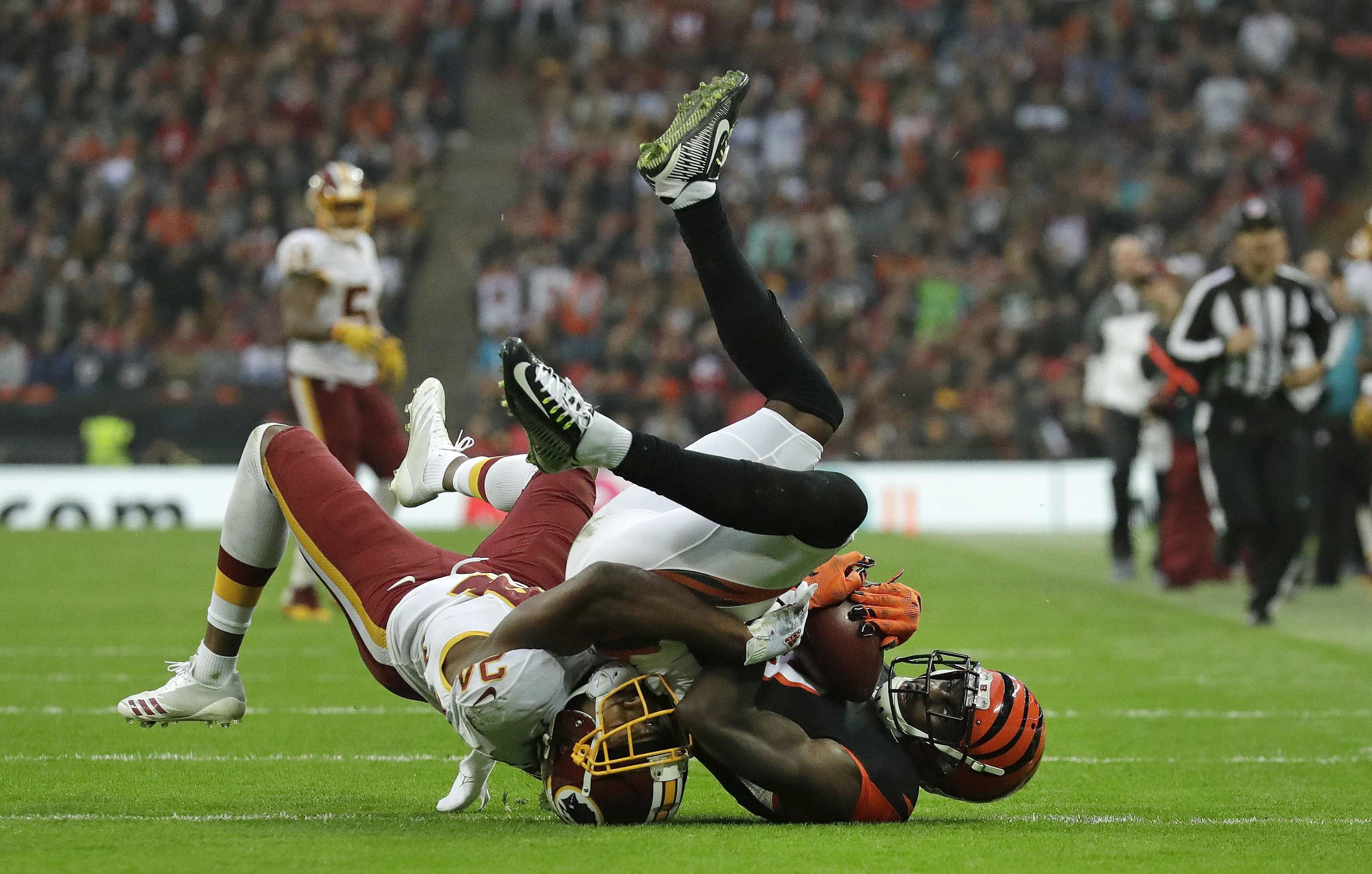 Cincinnati Bengals wide receiver A.J. Green (18), right, takes a catch despite the challenge of Washington Redskins cornerback Josh Norman (24) during an NFL Football game at Wembley Stadium in London, Sunday Oct. 30, 2016. (AP Photo/Matt Dunham)