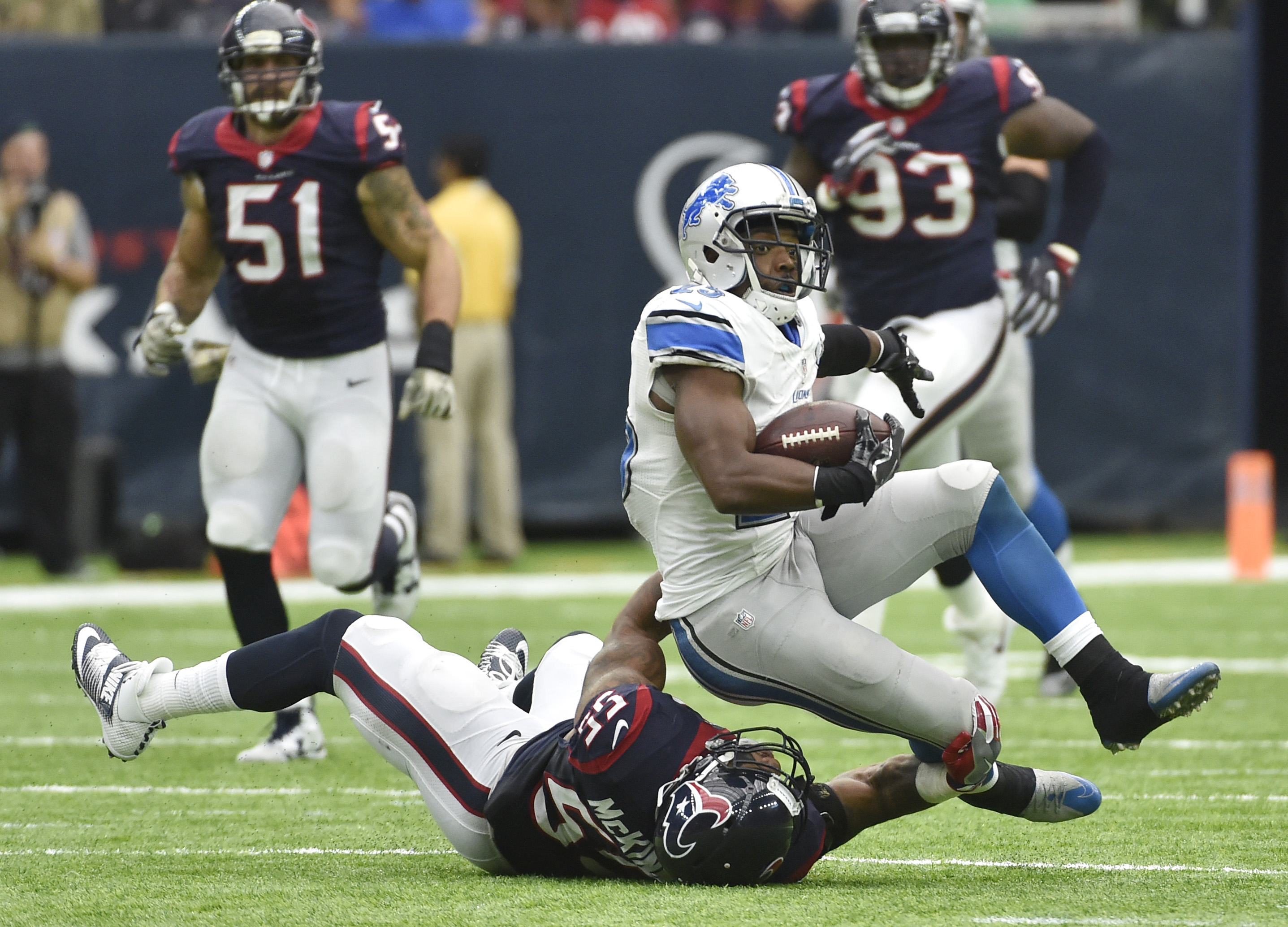Detroit Lions running back Theo Riddick (25) is stopped by Houston Texans defender Benardrick McKinney (55) during the second half of an NFL football game Sunday, Oct. 30, 2016, in Houston. (AP Photo/Eric Christian Smith)