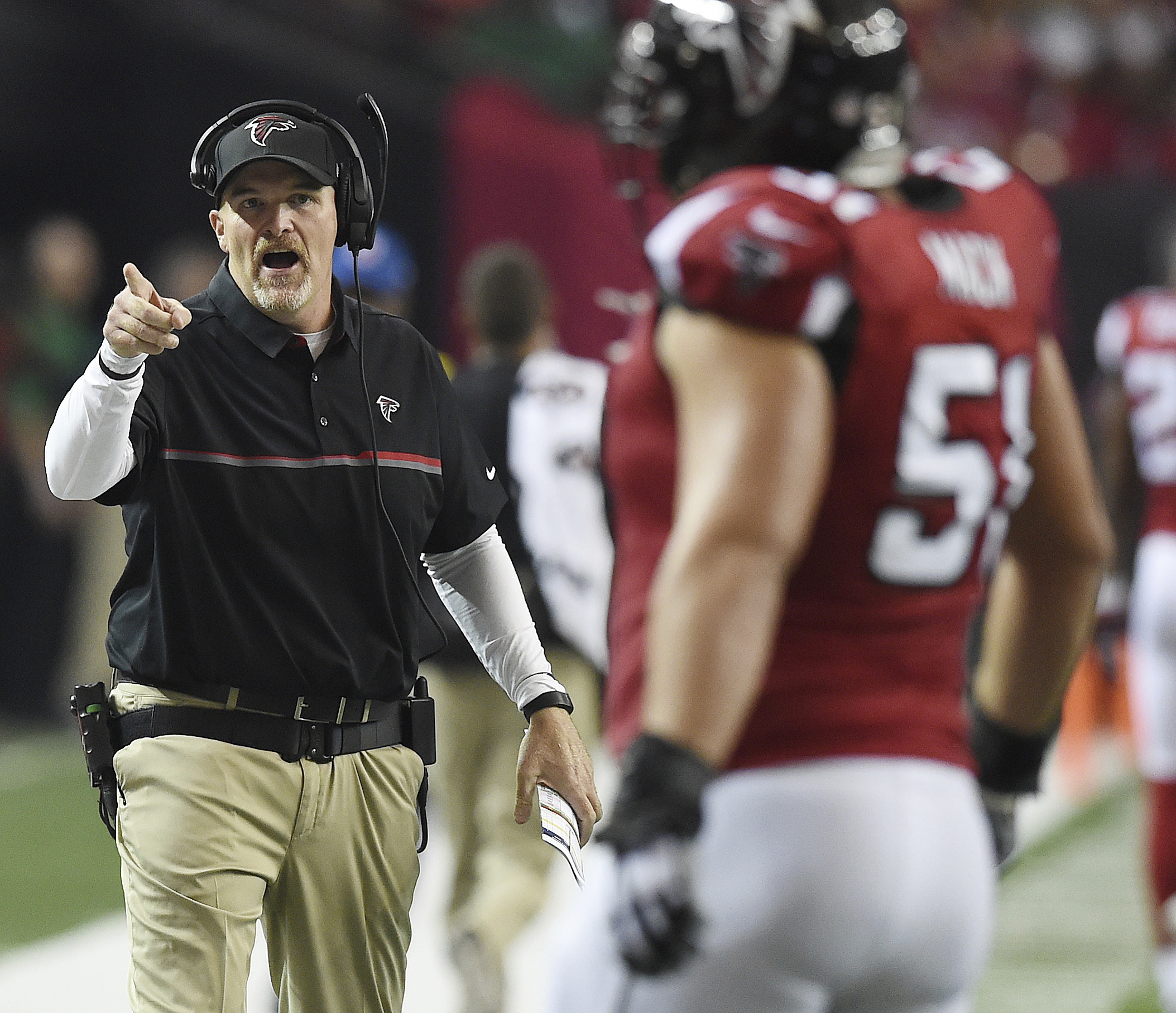 Atlanta Falcons head coach Dan Quinn speaks to Atlanta Falcons defensive end Brooks Reed (50) during the first of an NFL football game between the Atlanta Falcons and the Green Bay Packers, Sunday, Oct. 30, 2016, in Atlanta. (AP Photo/Rainier Ehrhardt)