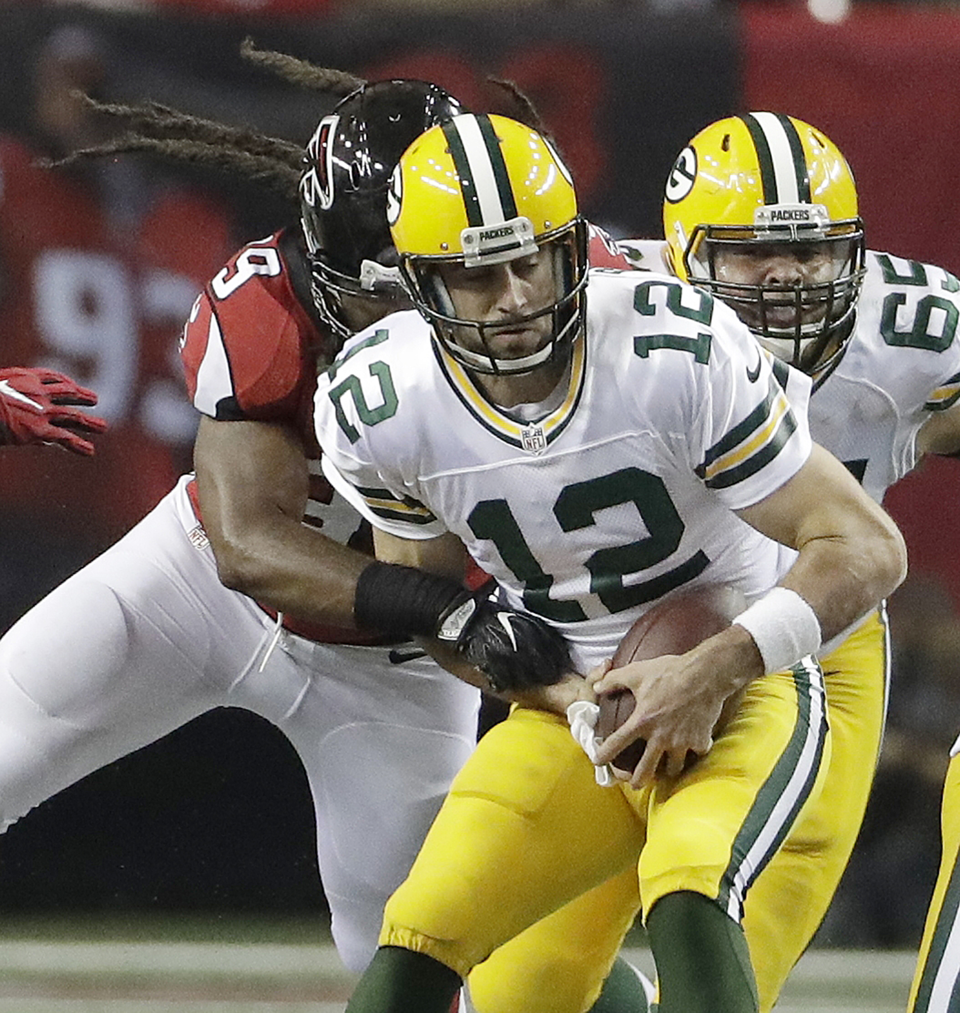 Atlanta Falcons defensive end Adrian Clayborn (99) sacks Green Bay Packers quarterback Aaron Rodgers (12) during the second of an NFL football game, Sunday, Oct. 30, 2016, in Atlanta. (AP Photo/David Goldman)