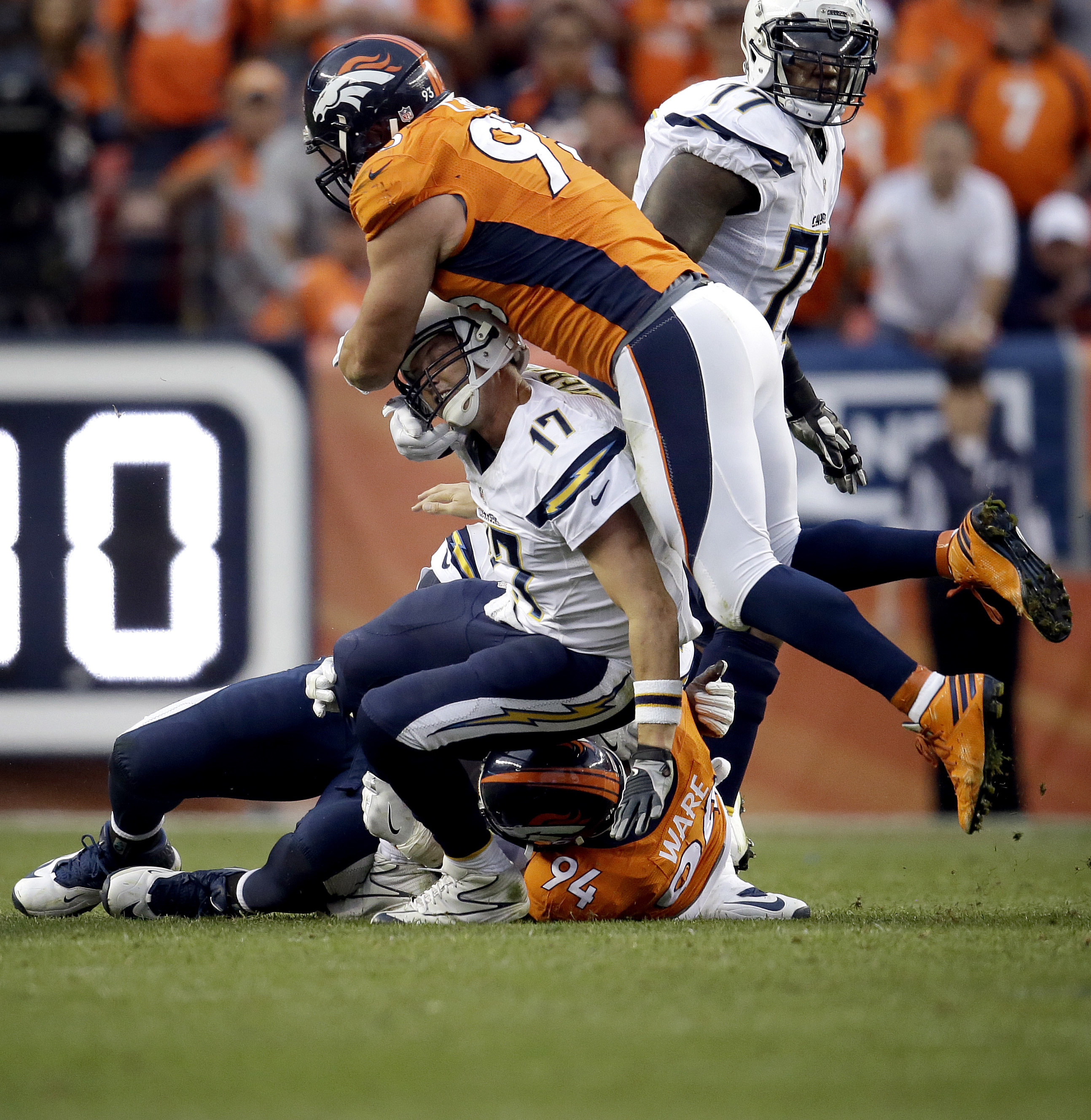 Denver Broncos defensive end Jared Crick (93) and linebacker DeMarcus Ware (94) hit San Diego Chargers quarterback Philip Rivers (17) after the throw during the second half of an NFL football game, Sunday, Oct. 30, 2016, in Denver. The Broncos won 27-19.