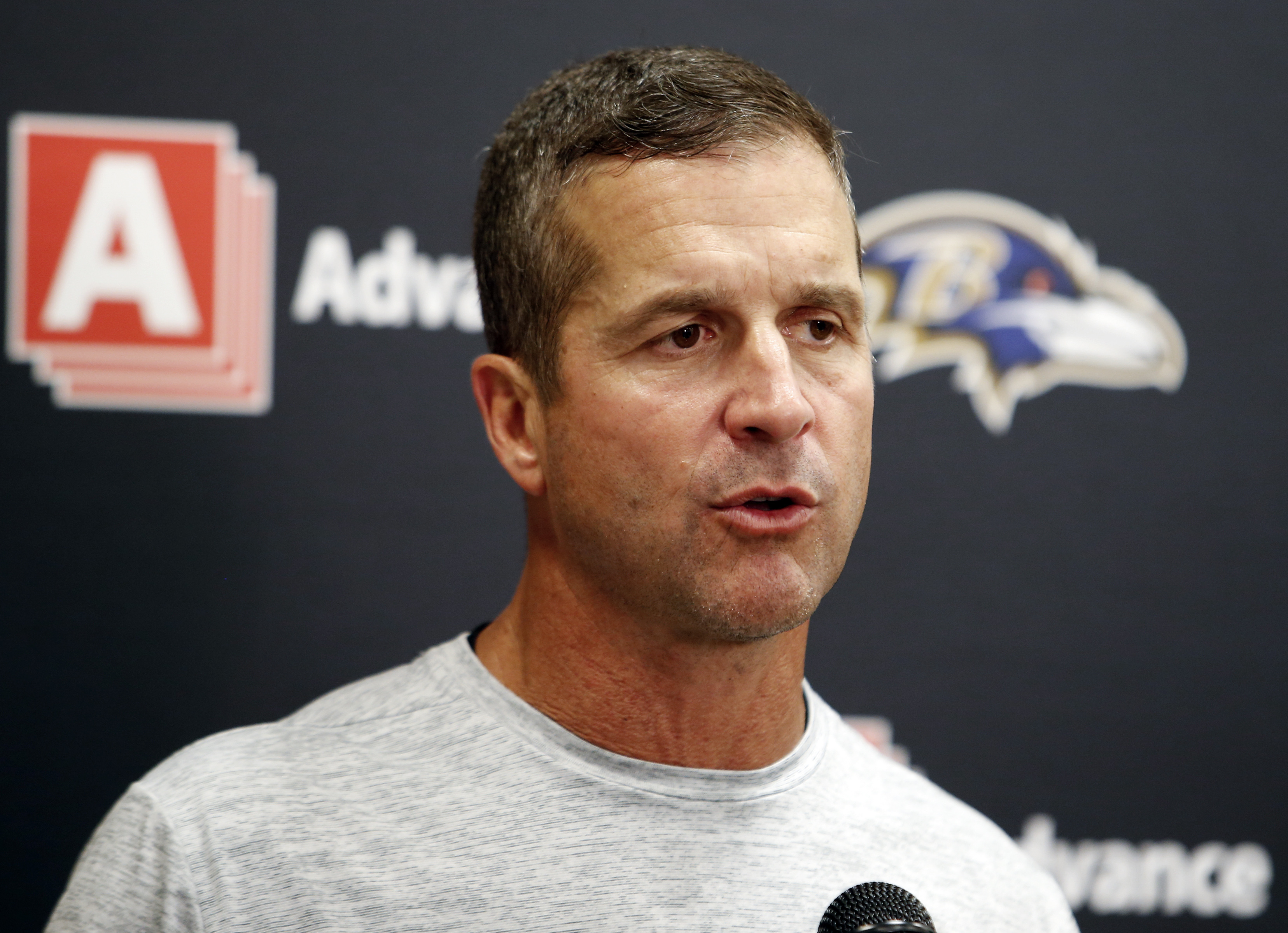 FILE - In this Sept. 18, 2016, file photo, Baltimore Ravens head coach John Harbaugh speaks to the media during a news conference after an NFL football game against the Cleveland Browns, in Cleveland.  The Ravens returned from their bye week rested, heale