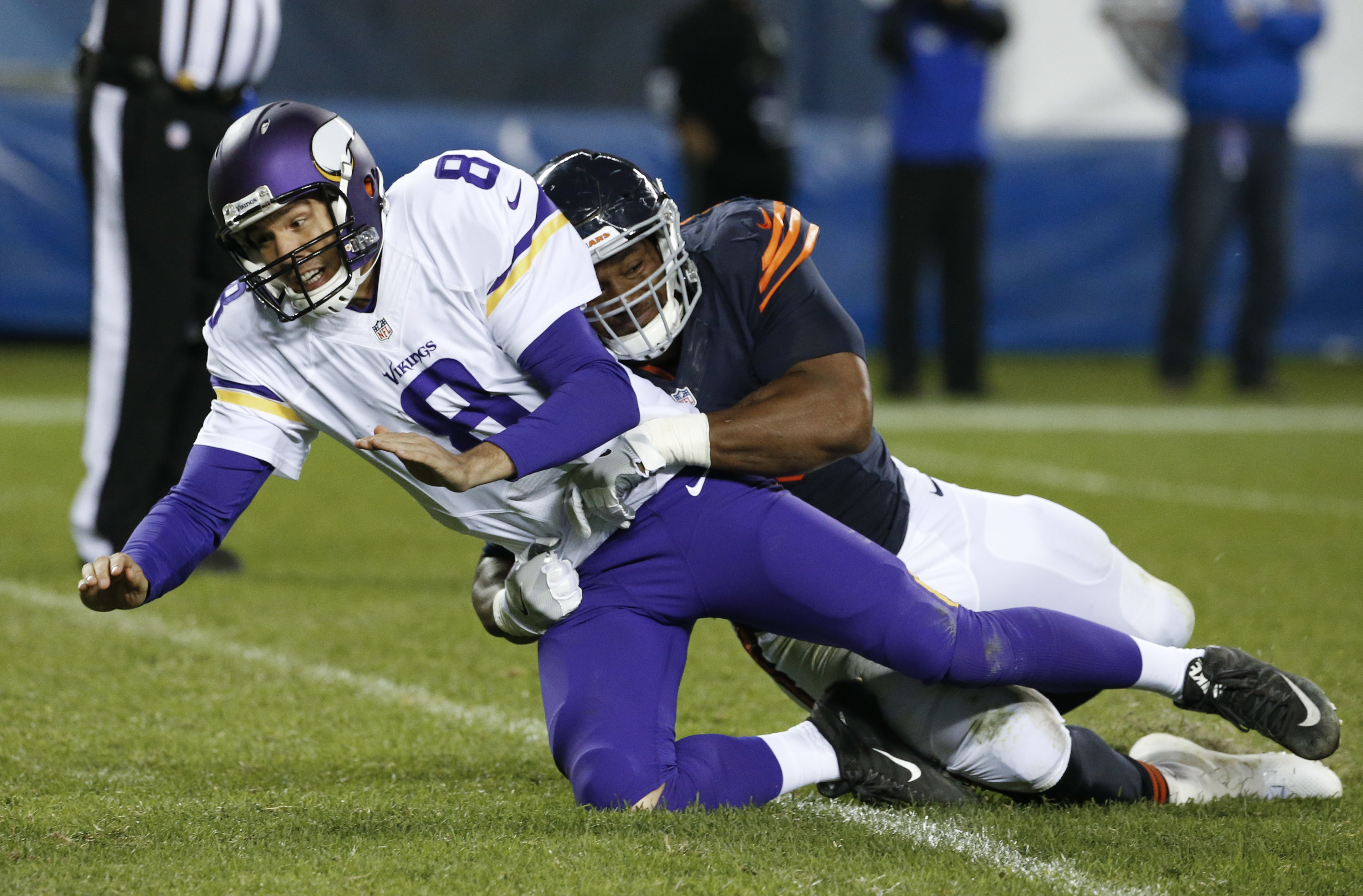 Chicago Bears defensive end Cornelius Washington (90) pressures Minnesota Vikings quarterback Sam Bradford (8) after a throw during the second half of an NFL football game in Chicago, Monday, Oct. 31, 2016. (AP Photo/Nam Y. Huh)