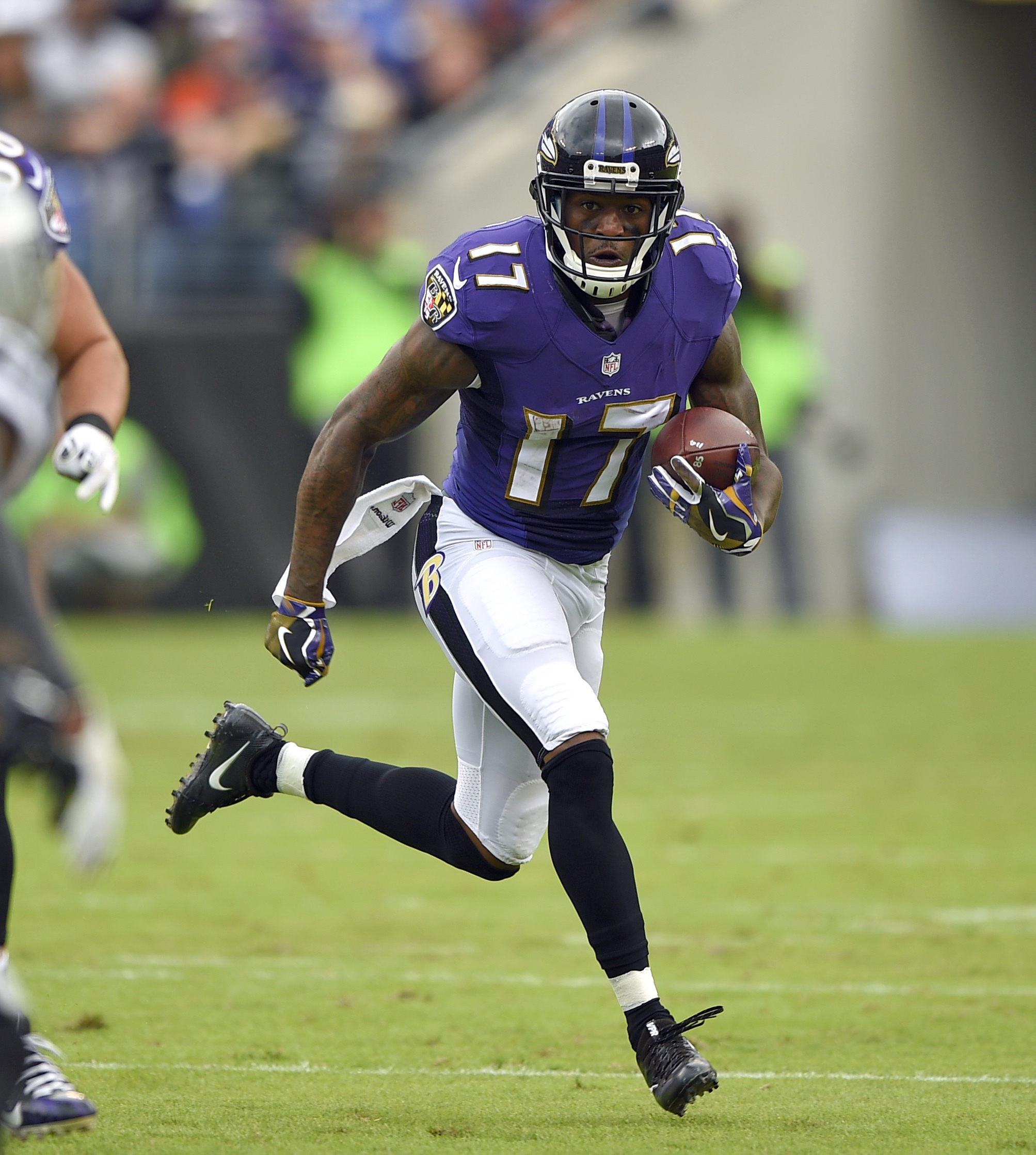FILE - In this Oct. 2, 2016, file photo, Baltimore Ravens wide receiver Mike Wallace rushes the ball in the first half of an NFL football game against the Oakland Raiders, in Baltimore. As a member of the Pittsburgh Steelers, Mike Wallace grew to despise