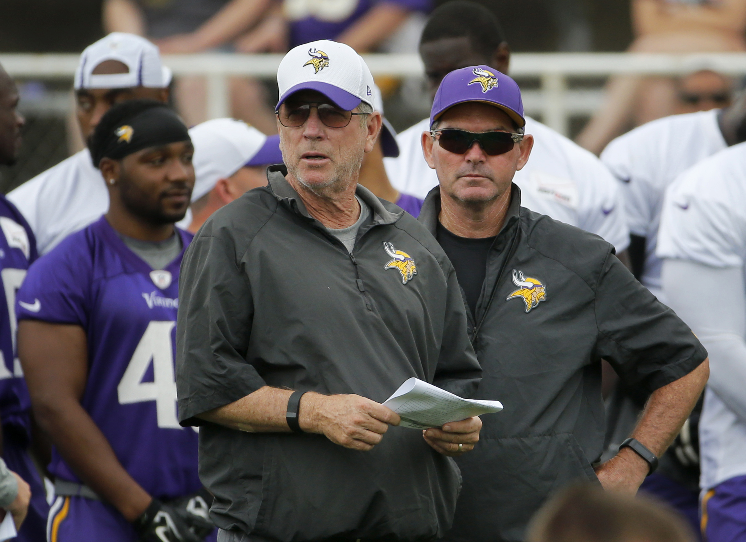 FILE - In this July 27, 2015, file photo, Minnesota Vikings offensive coordinator Norv Turner, left, and head coach Mike Zimmer watch practice at an NFL football training camp on the campus of Minnesota State University, in Mankato, Minn. Vikings offensiv