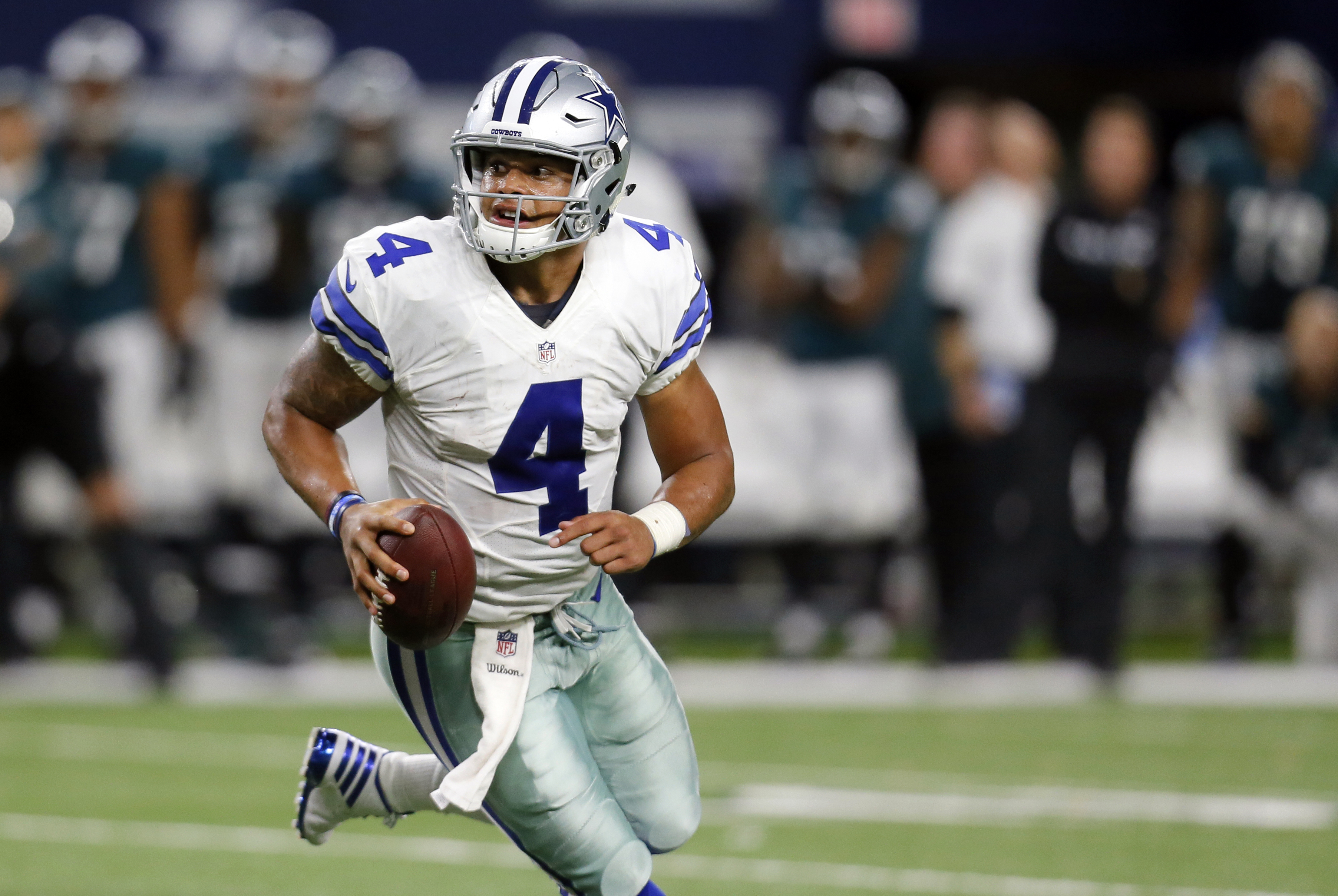 FILE - In this Sunday, Oct. 30, 2016, file photo, Dallas Cowboys quarterback Dak Prescott scrambles out of the pocket during an NFL football game against the Philadelphia Eagles in Arlington, Texas. As Dallas rookie quarterback's winning streak grows, Jer