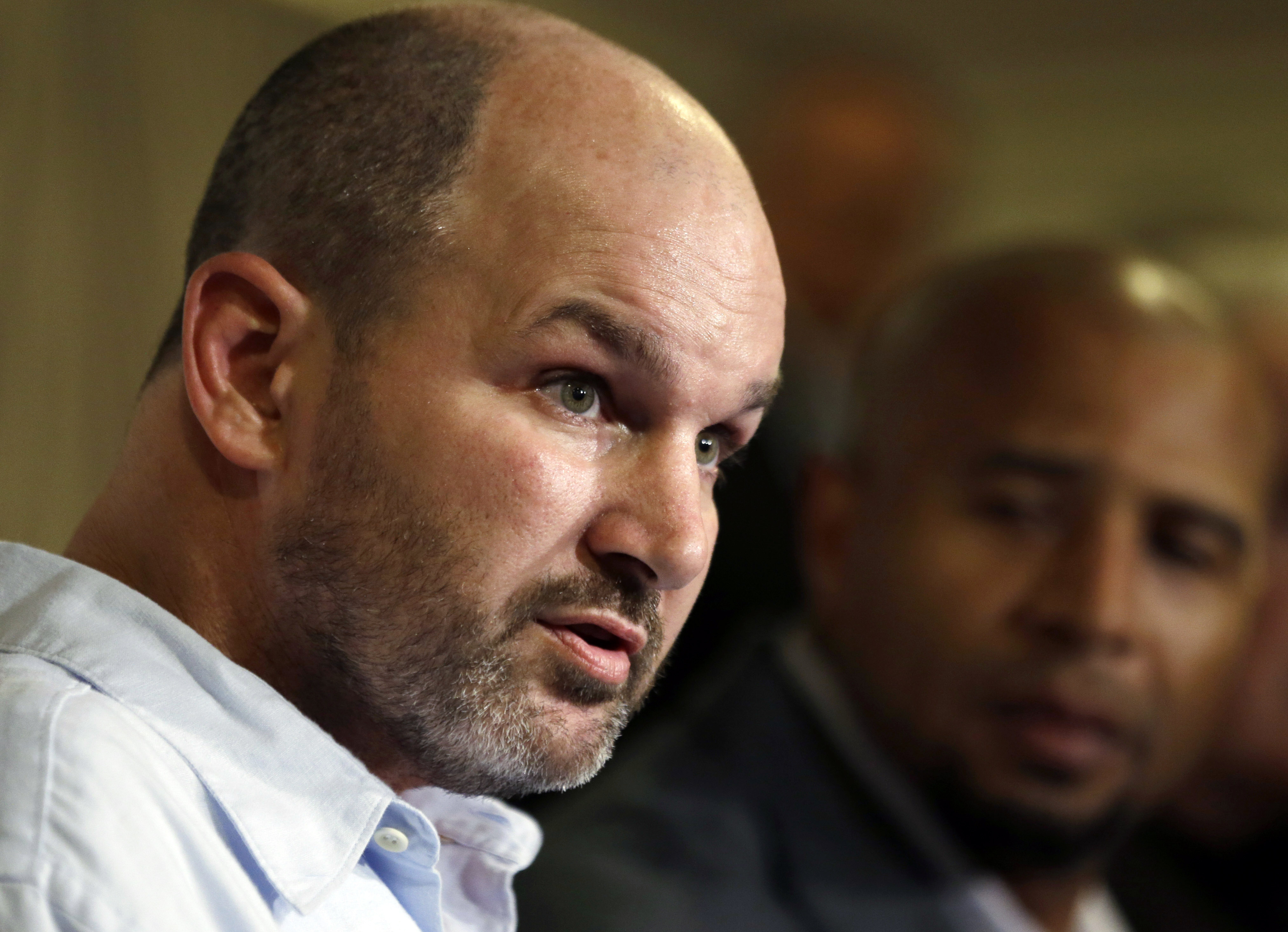 FILE - In this April 9, 2013 file photo, former NFL player Kevin Turner, left, speaks beside former player Dorsey Levens during a news conference in Philadelphia. Researchers in Boston announced Thursday, Nov. 3, 2016, that Turner, who died in March from