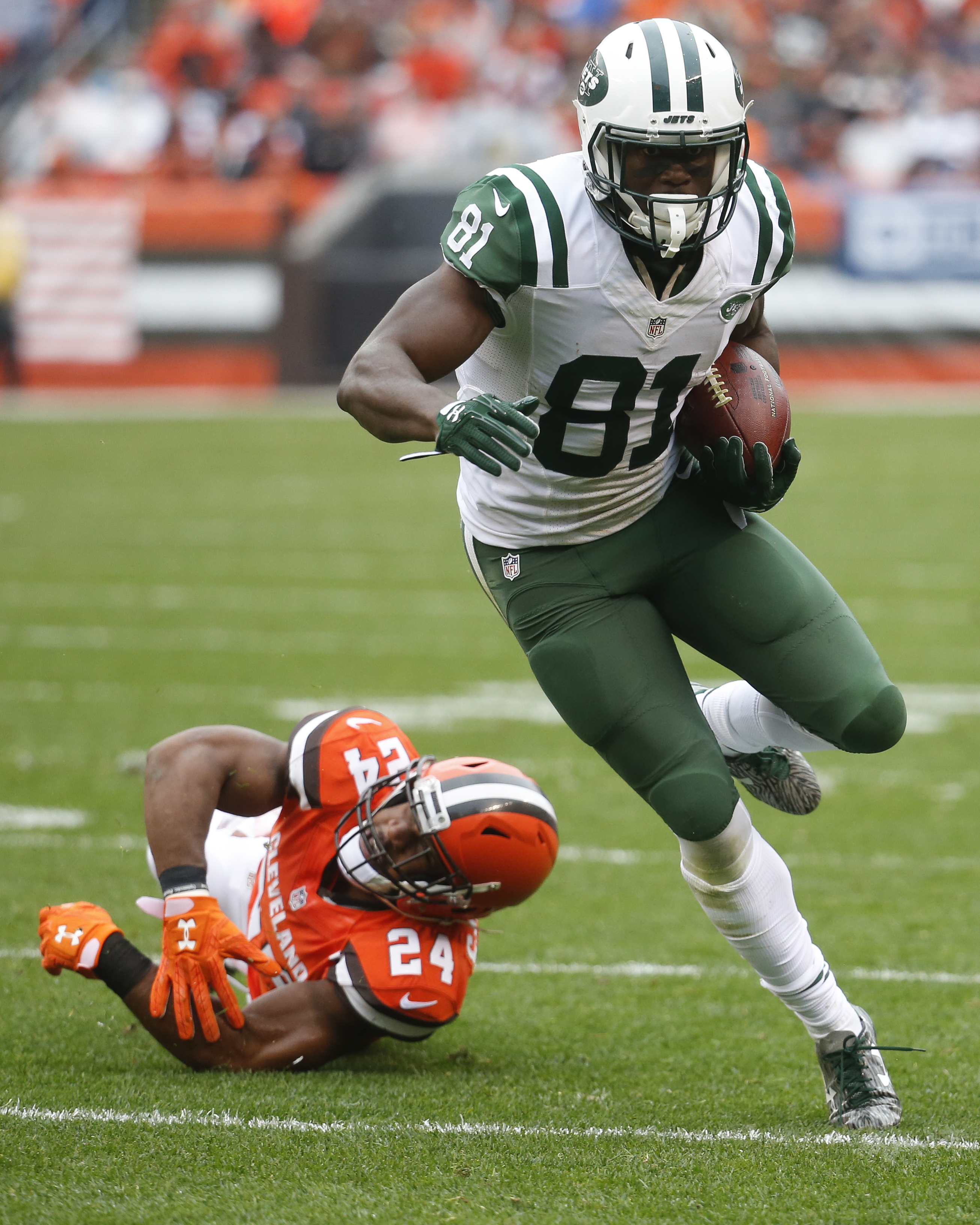FILE - In this Oct. 30, 2016, file photo, New York Jets wide receiver Quincy Enunwa (81) breaks away from Cleveland Browns strong safety Ibraheim Campbell, left, on a touchdown run in the second half of an NFL football game, in Cleveland. The 2014 sixth-r