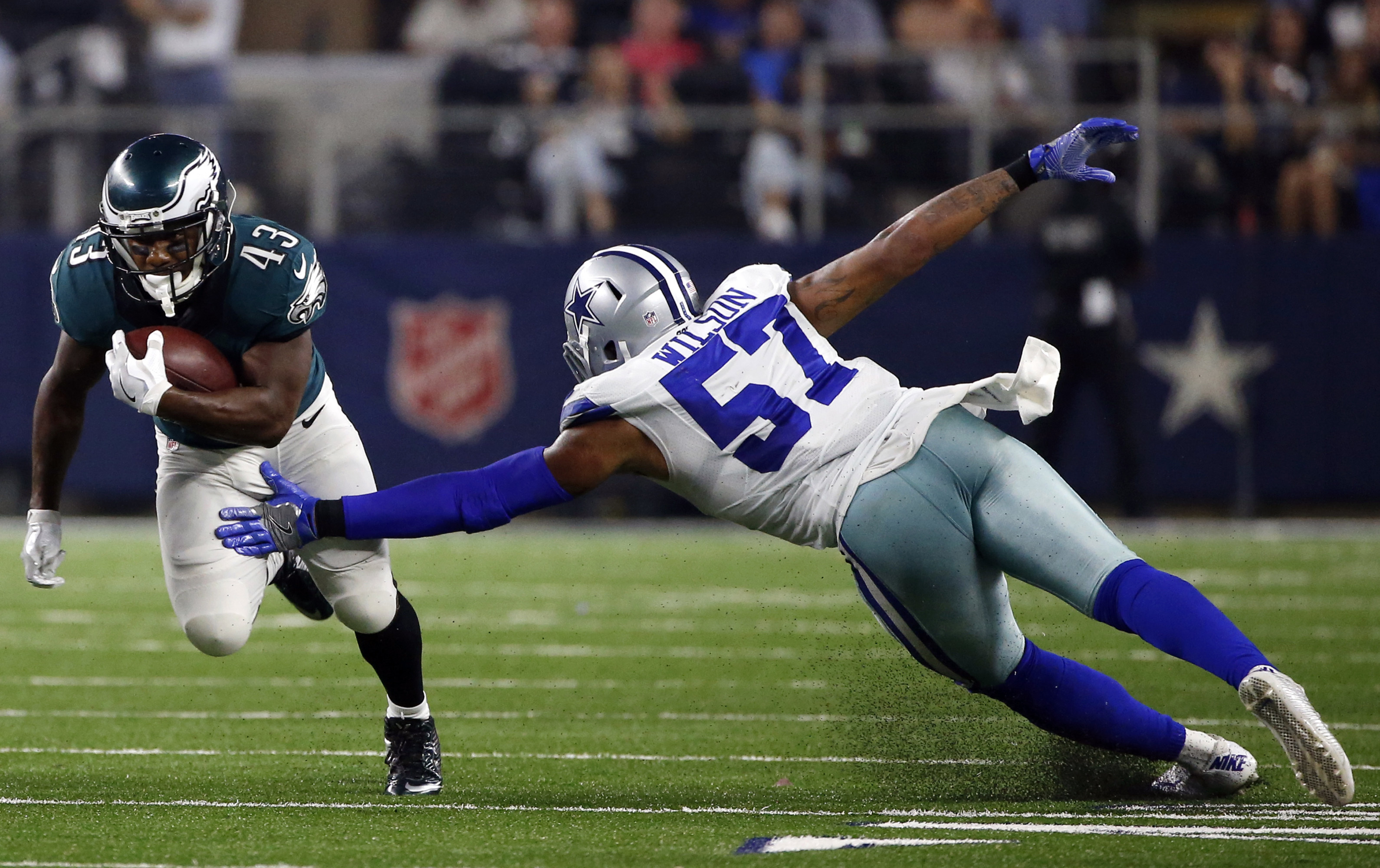 FILE - In this Oct. 30, 2016, file photo, Philadelphia Eagles' Darren Sproles (43) evades pressure from Dallas Cowboys' Damien Wilson (57) as he carries the ball for a long run during an NFL football game in Arlington, Texas. Sproles led the Eagles with 8