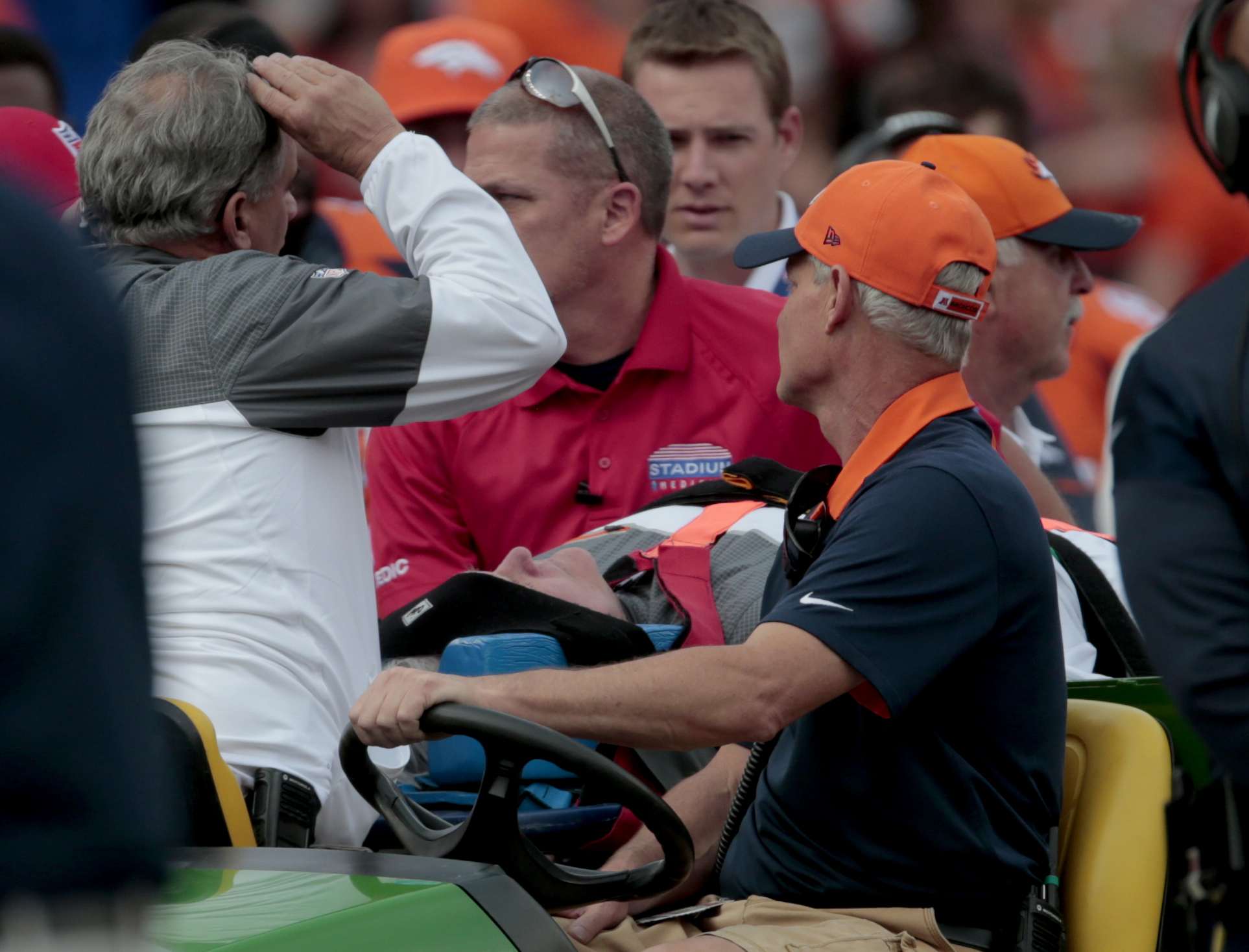 FILE - In this Oct. 30, 2016, file photo, Denver Broncos offensive coordinator Wade Phillips is carted off the field after being run into by a player while on standing on the sideline during the team's NFL football game against the San Diego Chargers in D