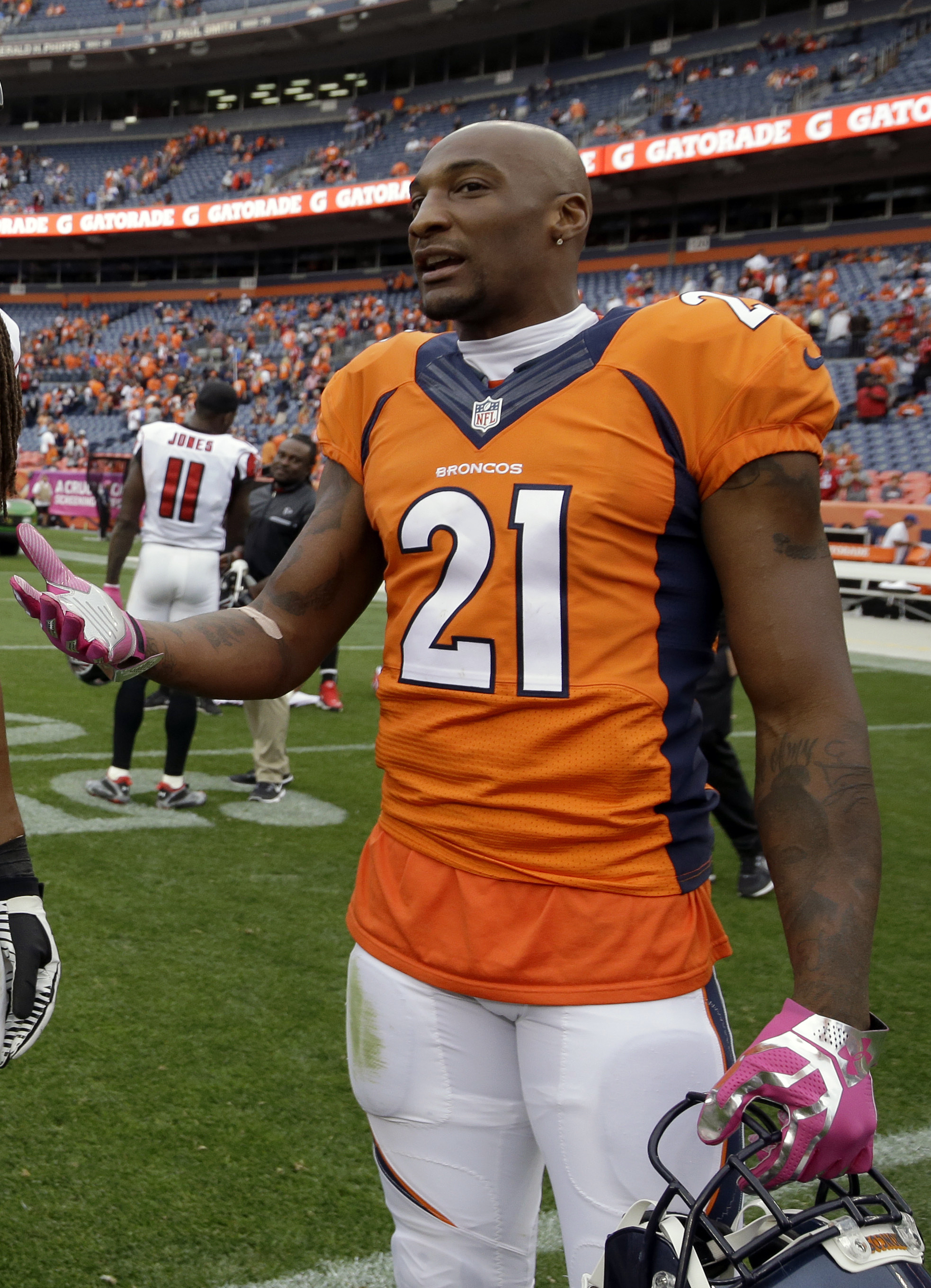 FILE - In this Oct. 9, 2016, file photo, Denver Broncos cornerback Aqib Talib gestures while talking on then sidelines after an NFL football game in Denver. The Broncos could be without Pro Bowl cornerback Aqib Talib for their Sunday night showdown with t