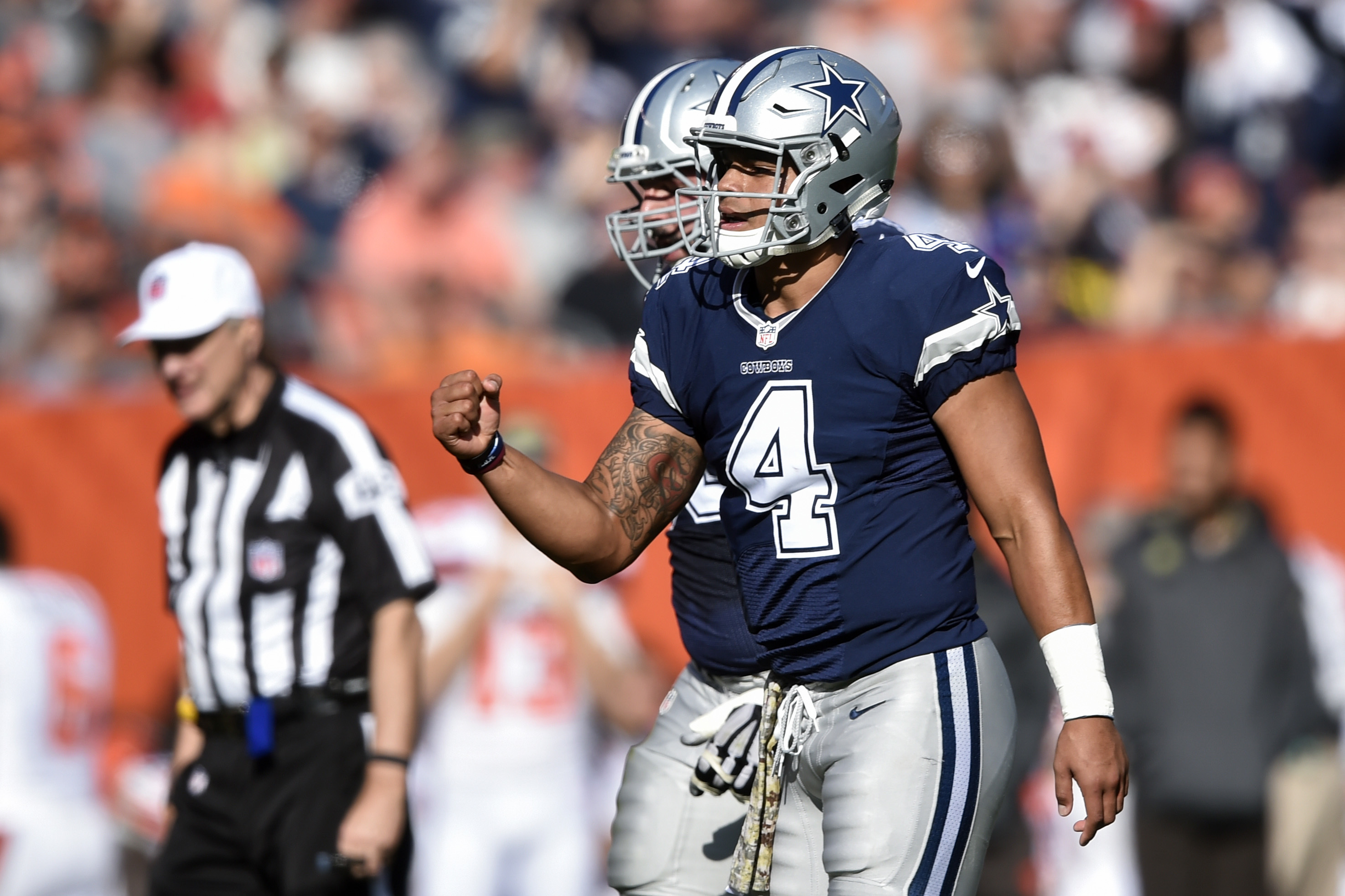 Dallas Cowboys quarterback Dak Prescott (4) reacts after tight end Jason Witten scored a touchdown in the first half of an NFL football game against the Cleveland Browns, Sunday, Nov. 6, 2016, in Cleveland. (AP Photo/David Richard)