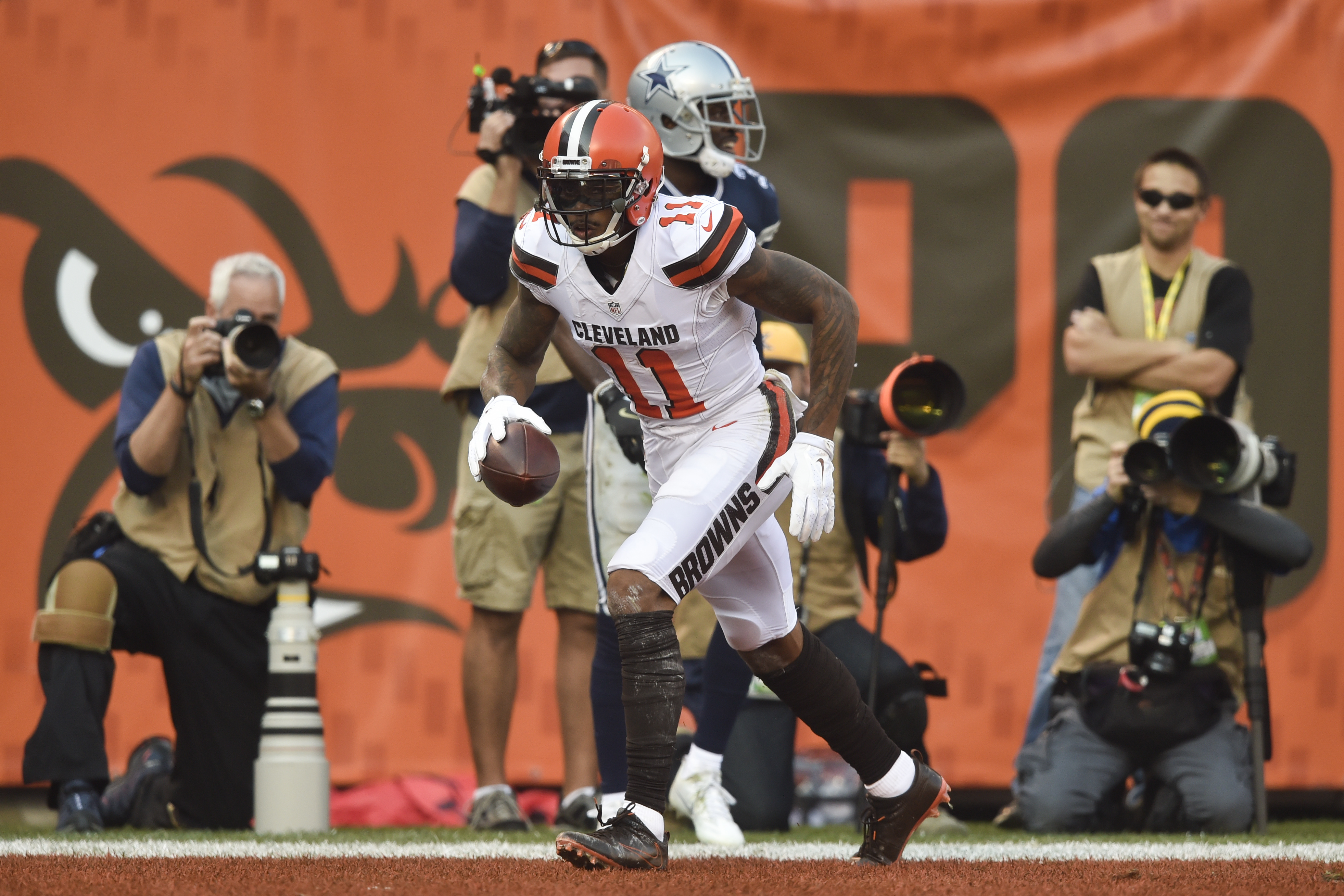 Cleveland Browns wide receiver Terrelle Pryor (11) runs the end zone after scoring a touchdown in the first half of an NFL football game against the Dallas Cowboys, Sunday, Nov. 6, 2016, in Cleveland. (AP Photo/David Richard)