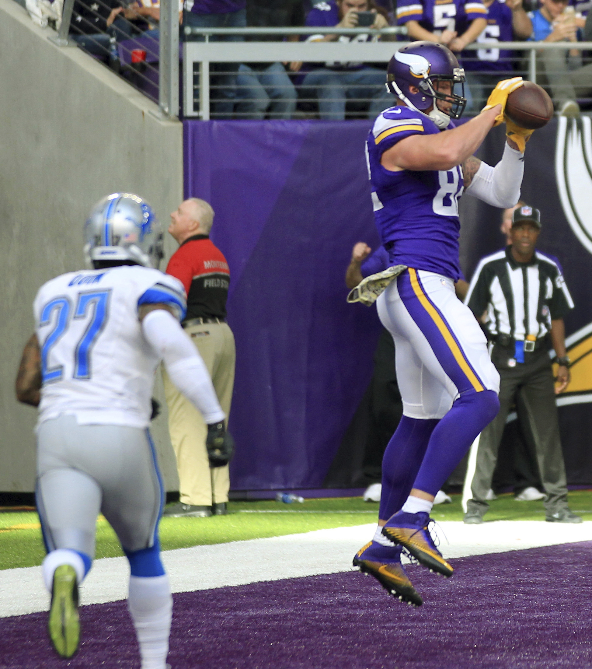 Minnesota Vikings tight end Kyle Rudolph, right, catches a 1-yard touchdown pass over Detroit Lions free safety Glover Quin (27) during the second half of an NFL football game Sunday, Nov. 6, 2016, in Minneapolis. (AP Photo/Andy Clayton-King)